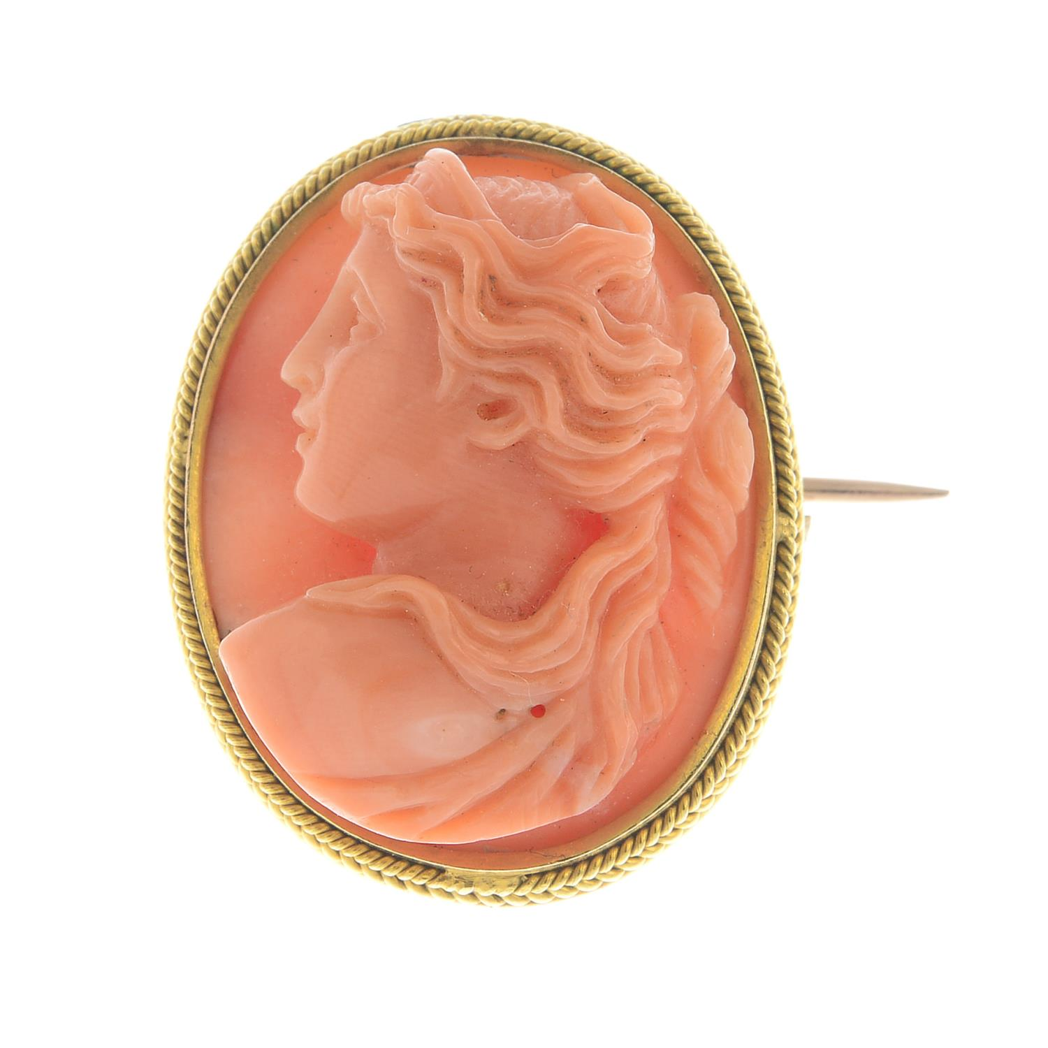 Lot 38 - A coral cameo brooch.Estimated dimensions of coral 22 by 17.3 by 8.4mms.Length 2.5cms.