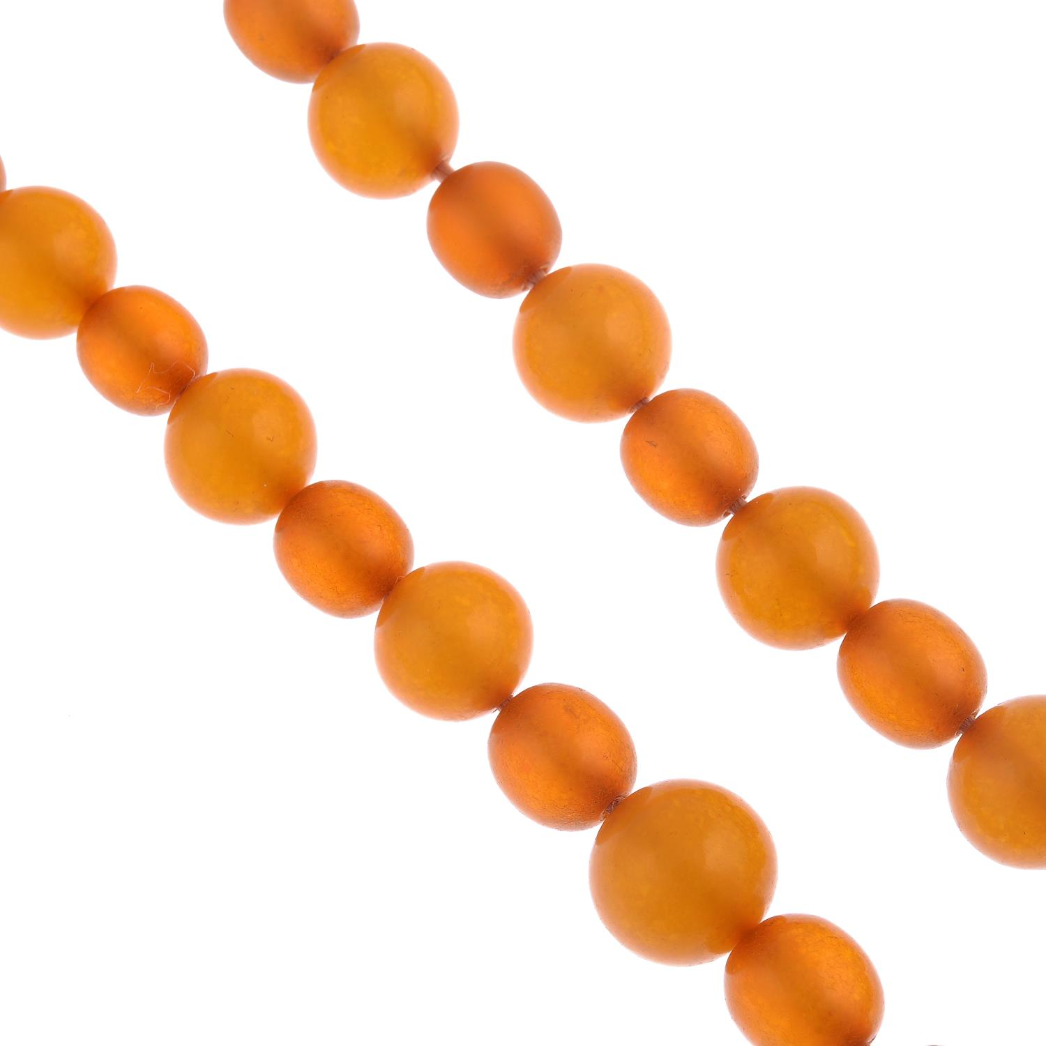 Lot 55 - An amber bead necklace.Sixty-eight beads, measuring 18 to 9mms.