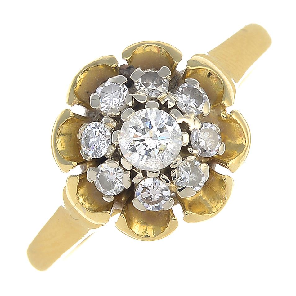 Lot 43 - A 1970s 18ct gold brilliant-cut diamond floral cluster ring.