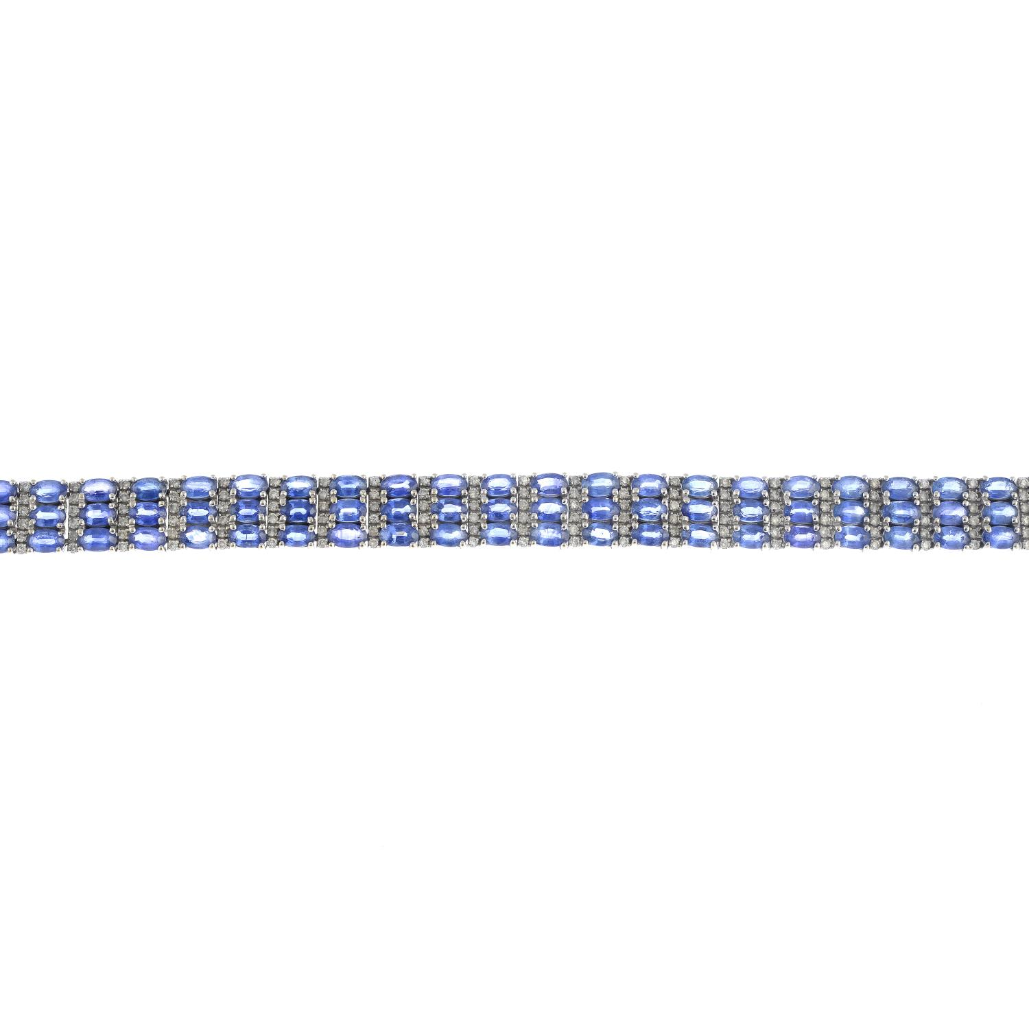 Lot 9 - A sapphire and diamond bracelet.Estimated total diamond weight 1.65cts.Stamped 14K.Length 18cms.