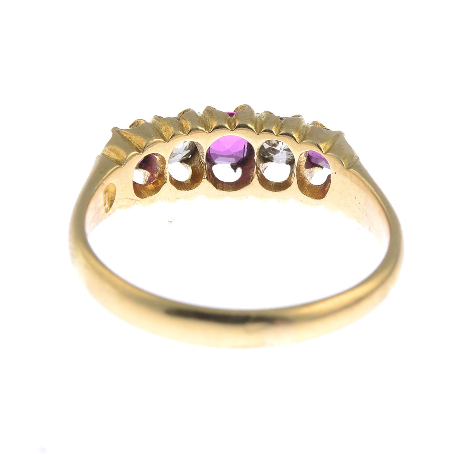 Lot 15 - A late Victorian18ct gold ruby and diamond five-stone ring.Estimated total diamond weight 0.30ct,