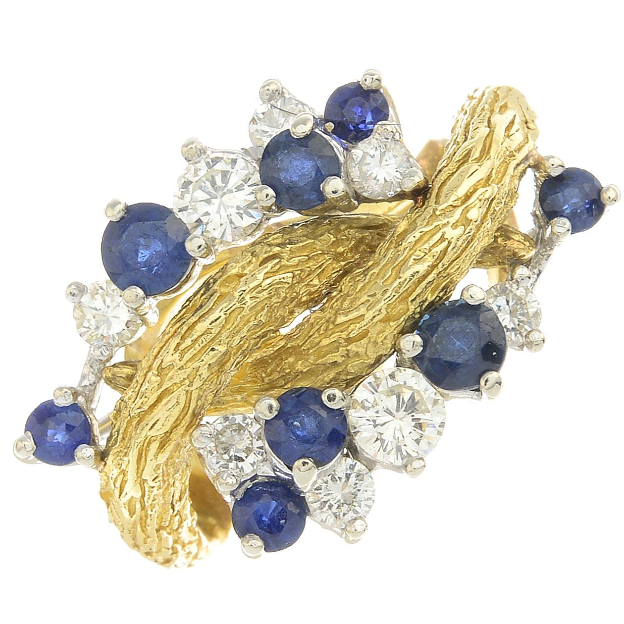 Lot 28 - A diamond and sapphire dress ring.Estimated total diamond weight 0.35ct,