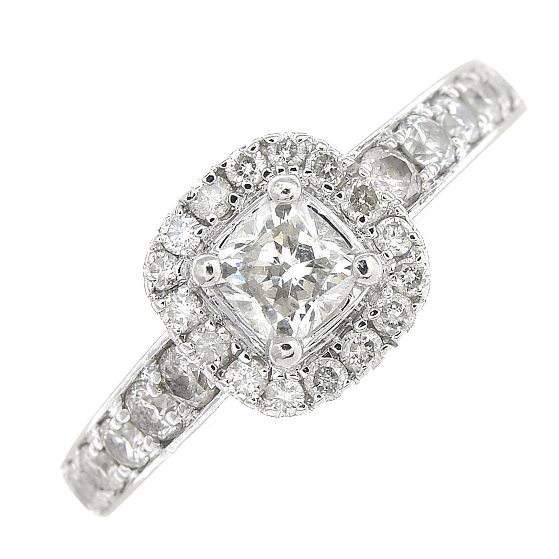 Lot 40 - A platinum diamond cluster ring.Total diamond weight 0.74ct,