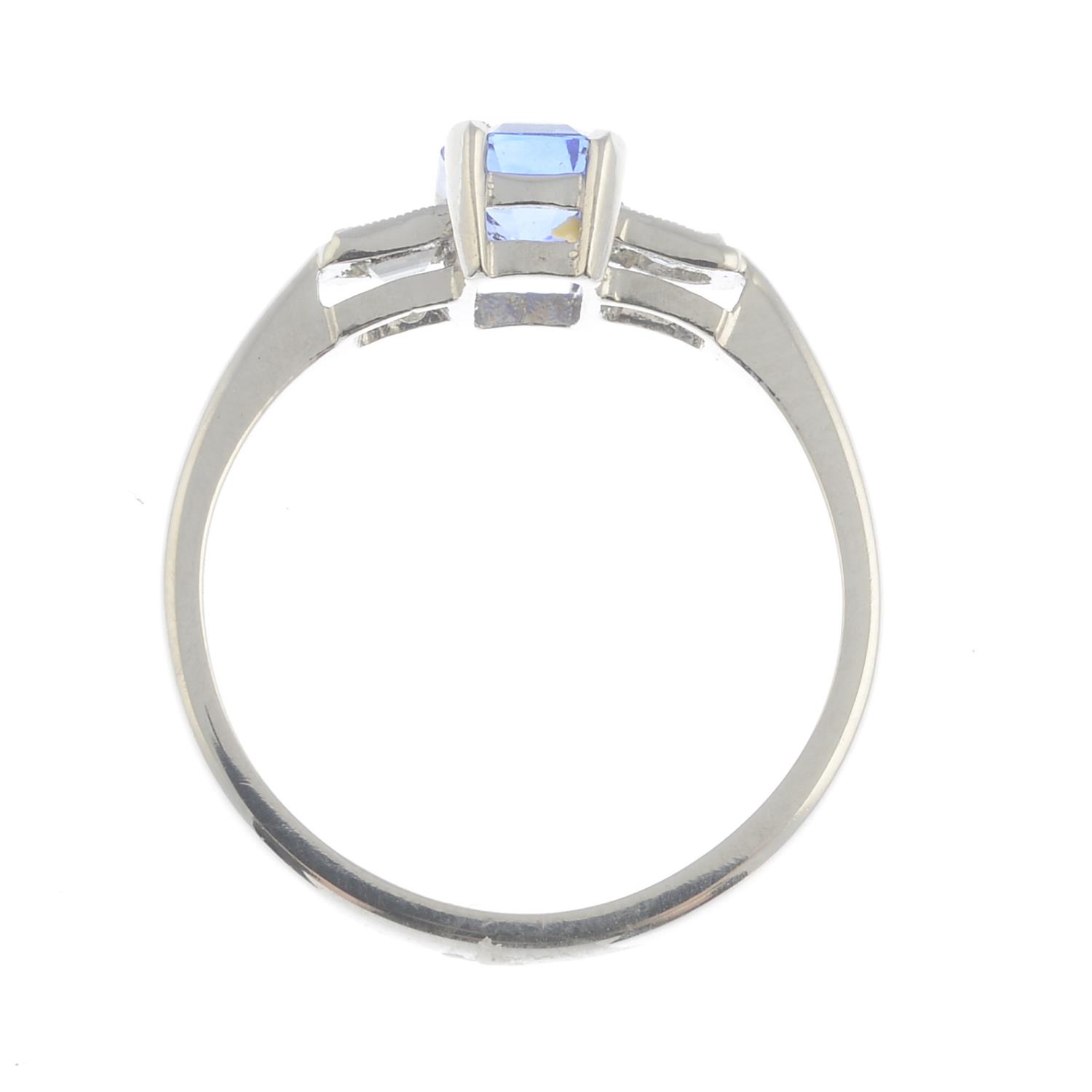 Lot 35 - A sapphire and diamond dress ring.Sapphire weight 0.85ct.