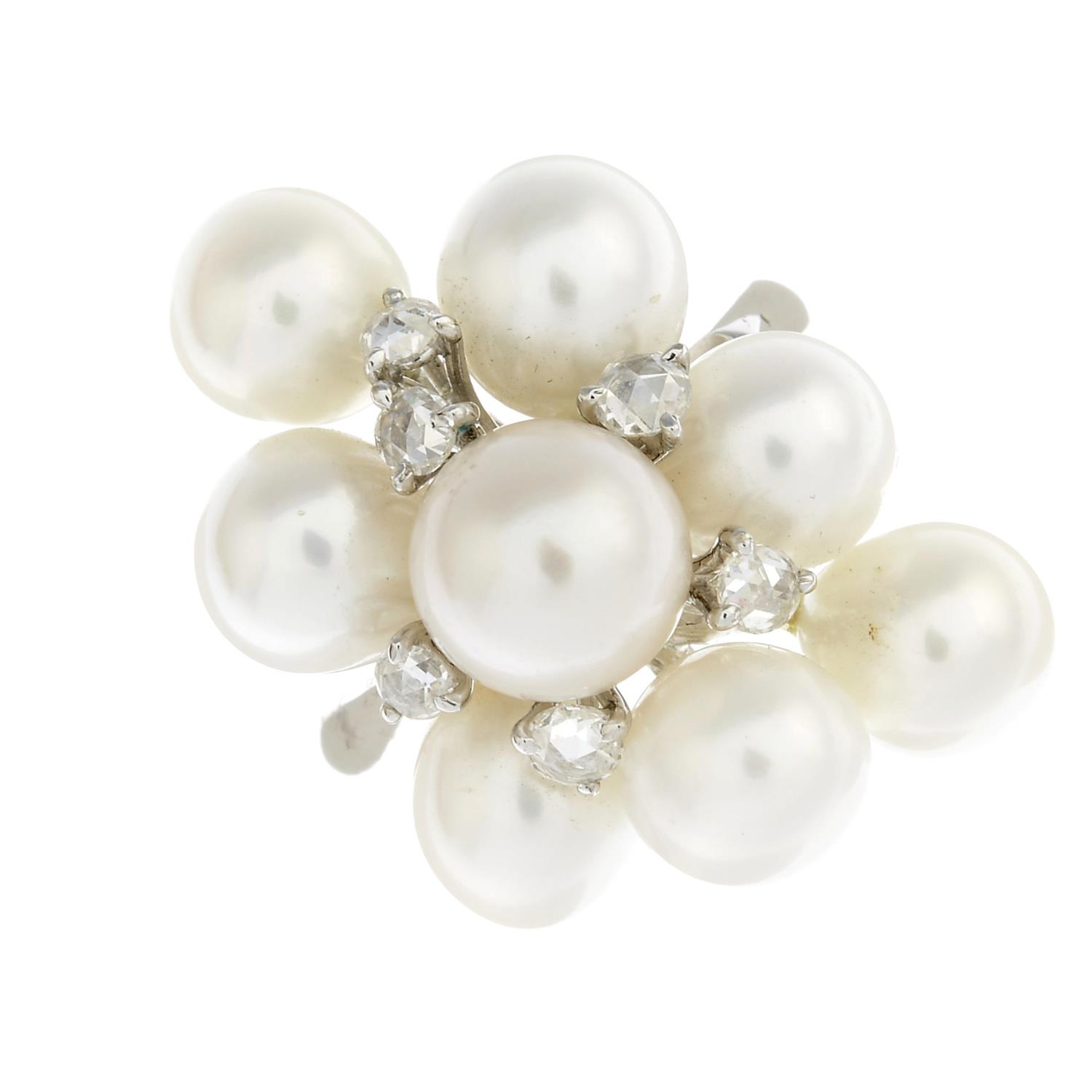 Lot 48 - A cultured pearl and diamond dress ring.Estimated diameters of cultured pearls 8 to 7mms.