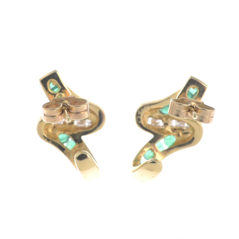Lot 57 - A pair of emerald and diamond earrings.Length 1.8cms.
