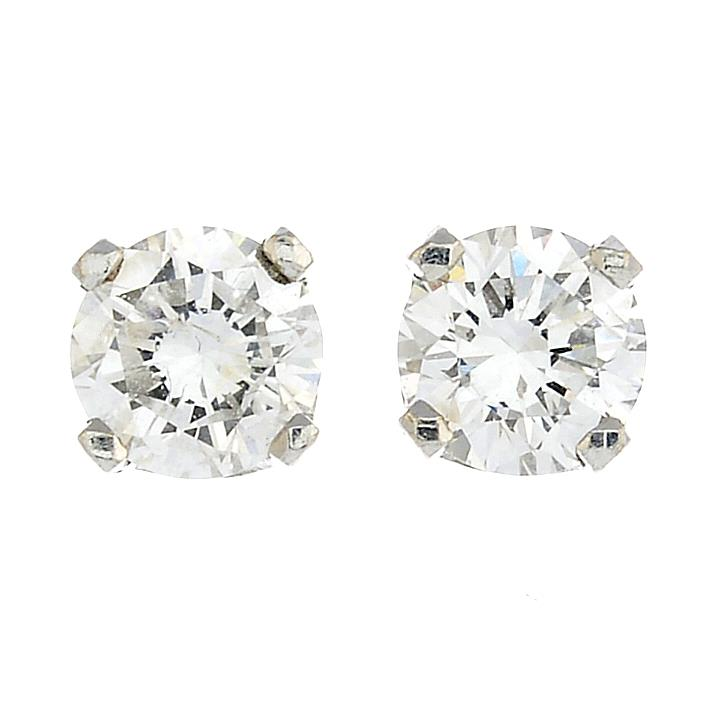 Lot 13 - A pair of brilliant-cut diamond stud earrings.Estimated total diamond weight 0.70ct,