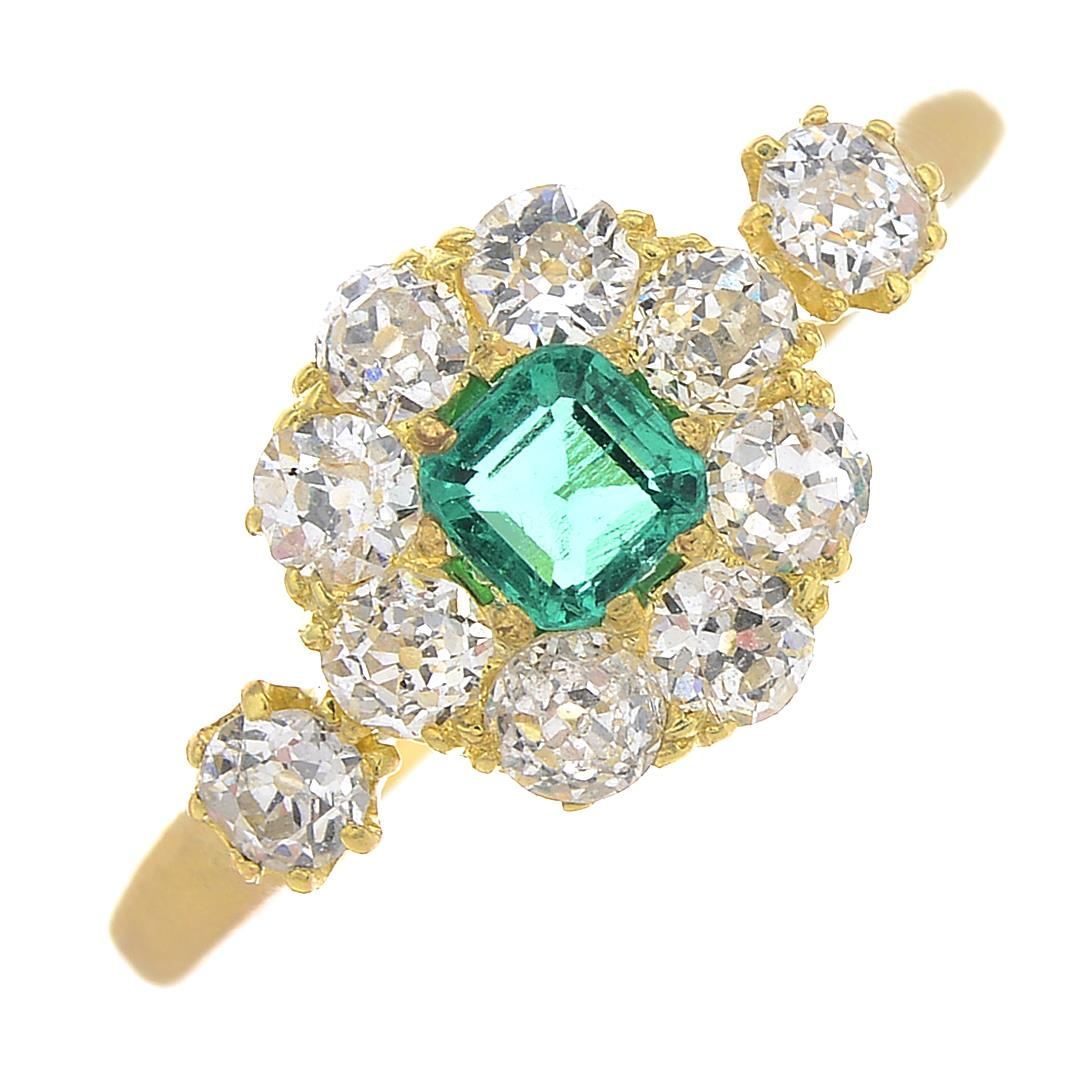 Lot 41 - An emerald and diamond cluster ring.