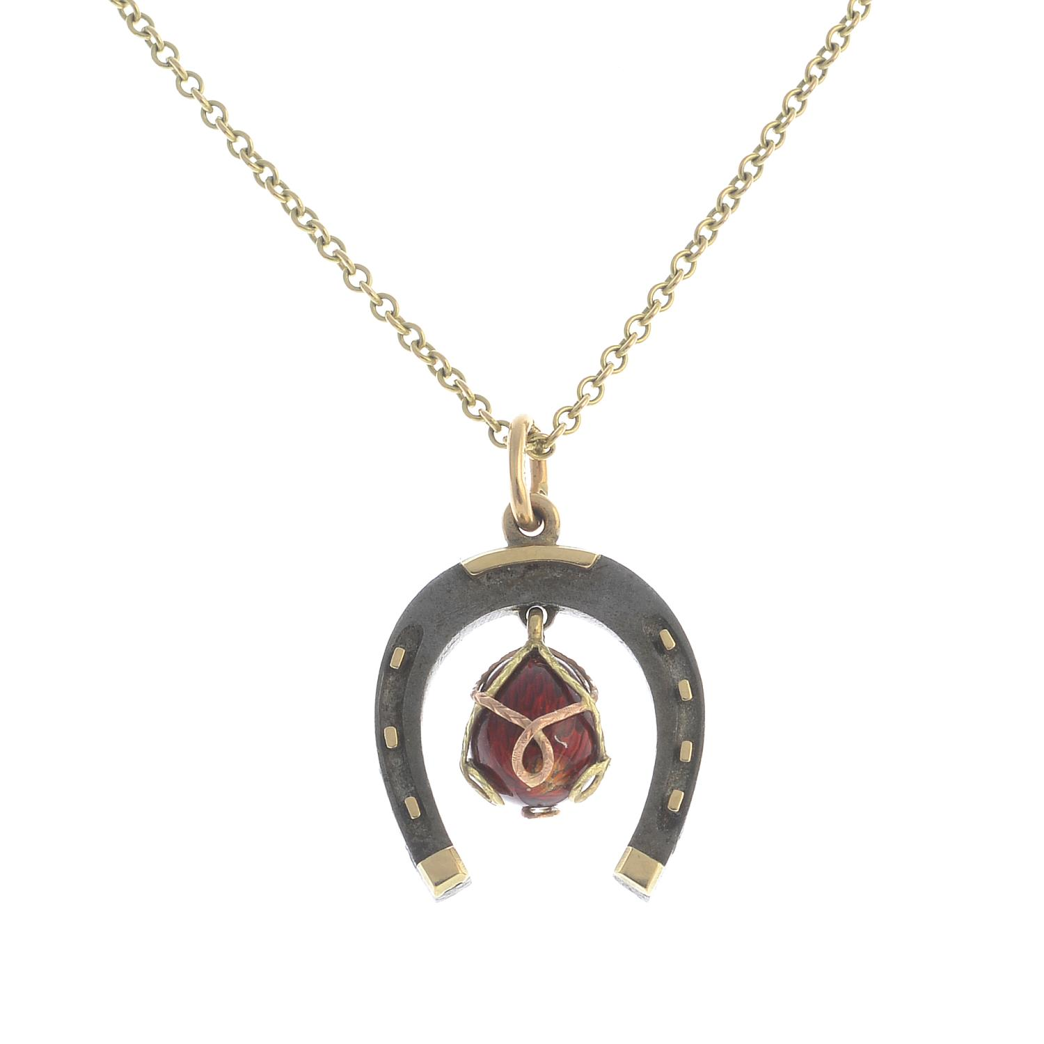 Lot 17 - An early 20th century 9ct gold and iron enamel horseshoe pendant,