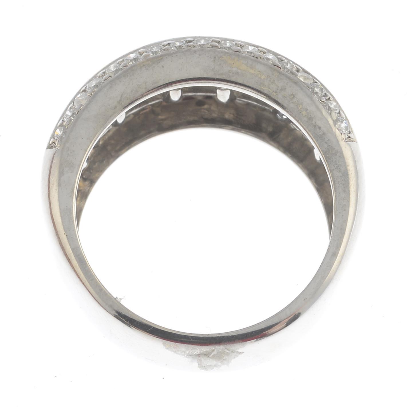 Lot 42 - A diamond dress ring.