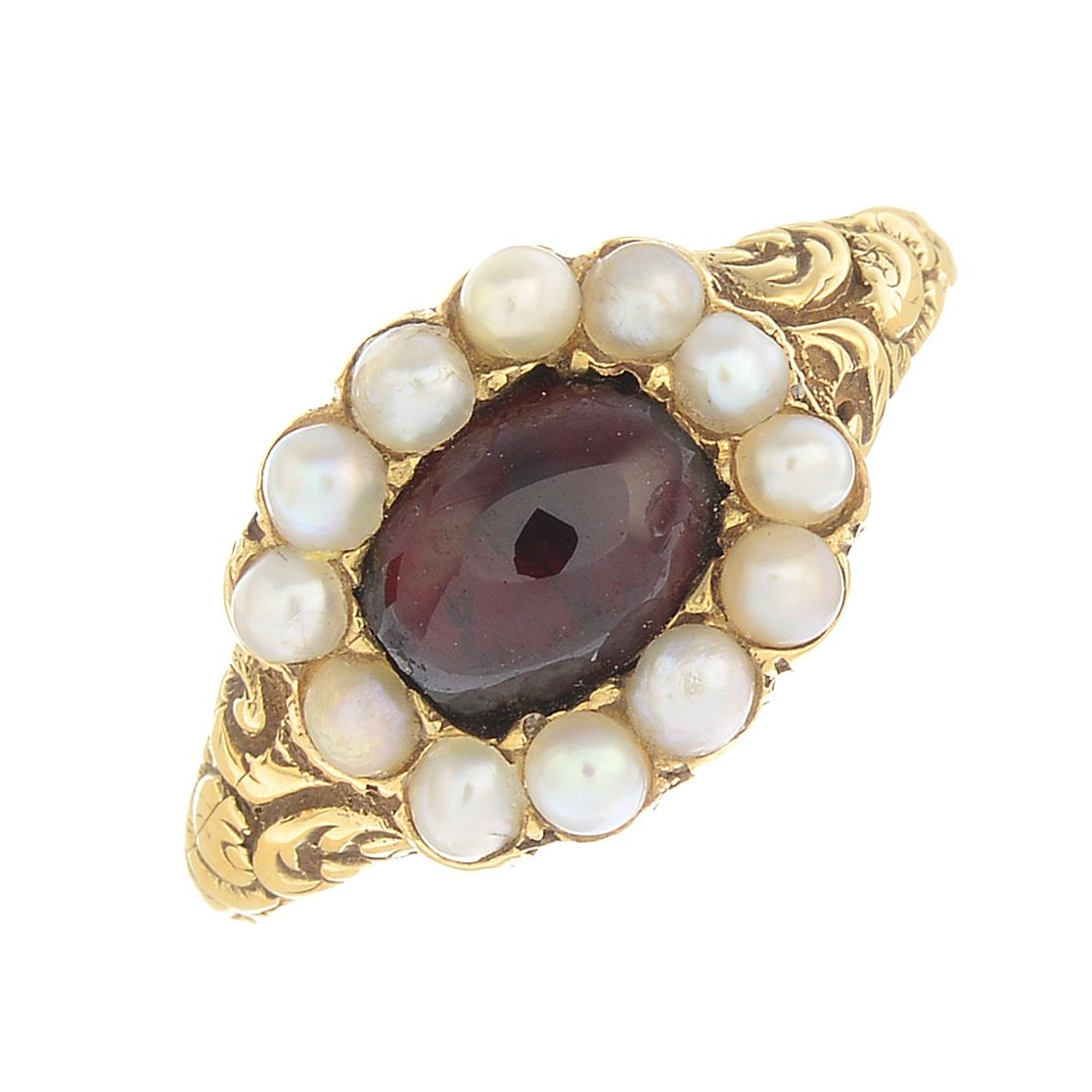 Lot 3 - A mid 19th century gold garnet and split pearl ring.Ring size M.