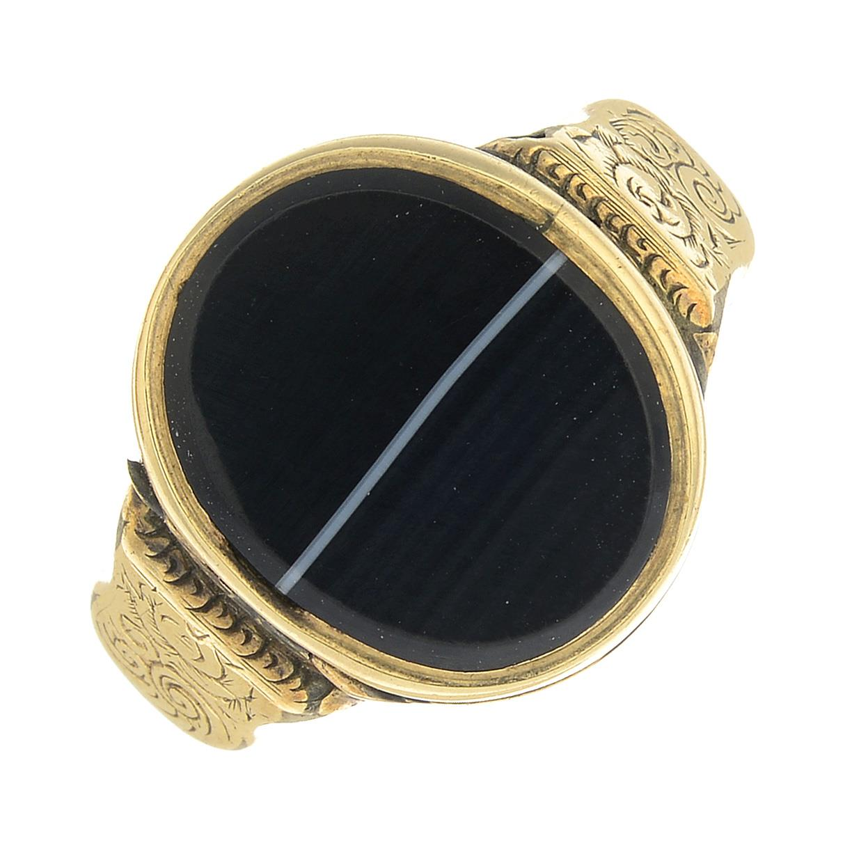Lot 19 - A mid Victorian gold, banded agate locket ring, circa 1856.Ring size N1/2.