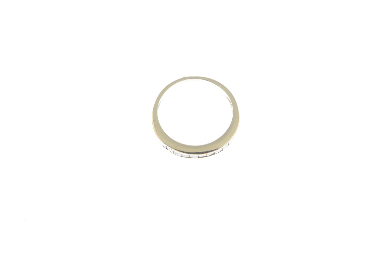 Lot 52 - A diamond half eternity ring.