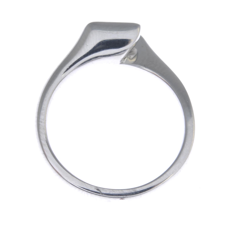 Lot 22 - A platinum diamond single-stone ring.