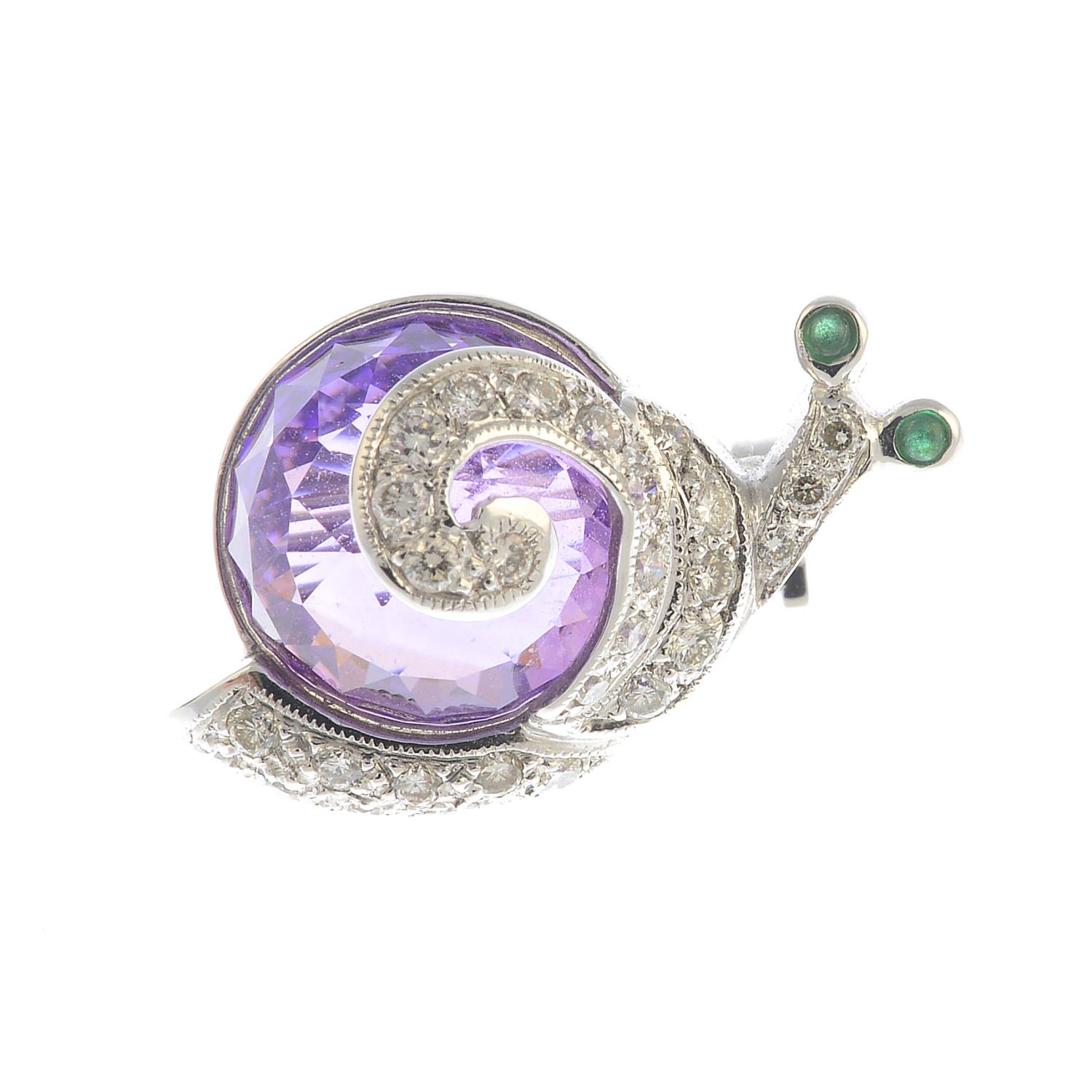 Lot 20 - A diamond, amethyst and emerald snail brooch.Estimated total diamond weight 0.20ct.Length 1.2cms.