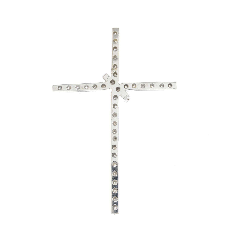 Lot 33 - A diamond cross pendant.