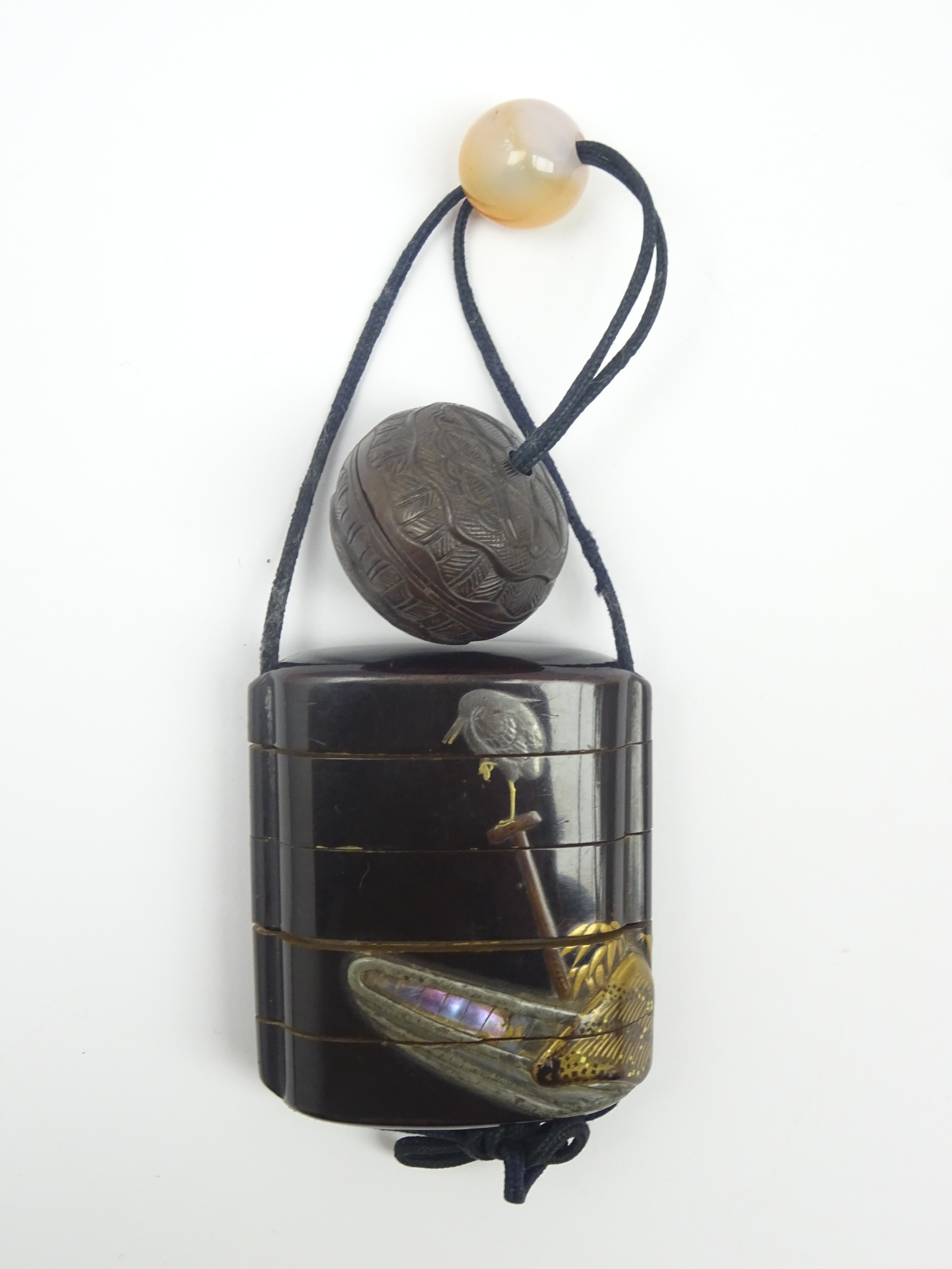 Lot 54 - Japanese lacquer four-case Inro with a cormorant seated on a pole beside a fishing boat on a black