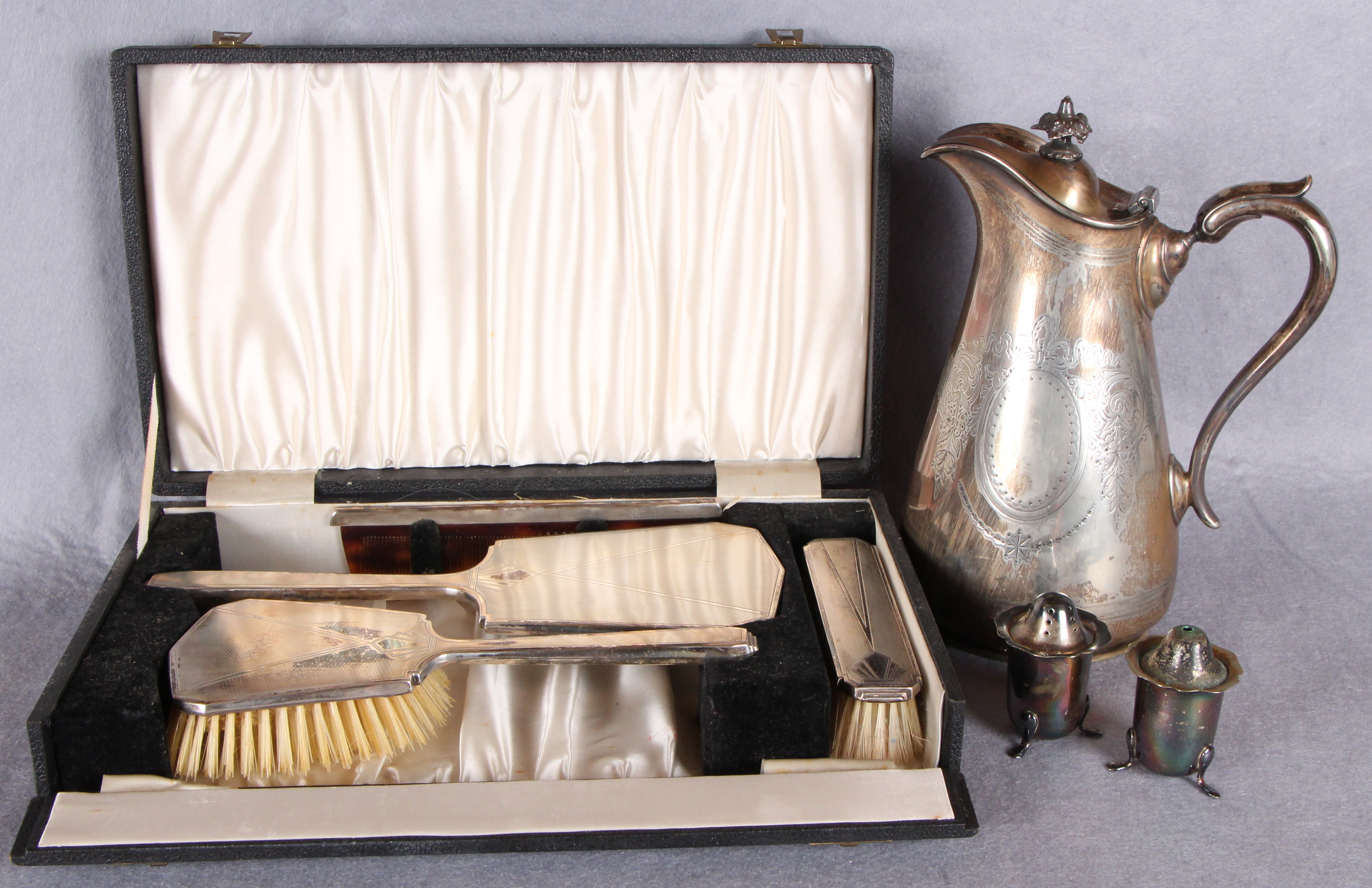 Lot 37 - A three piece engine engraved silver-mounted dressing table set comprising two brushes and a hand