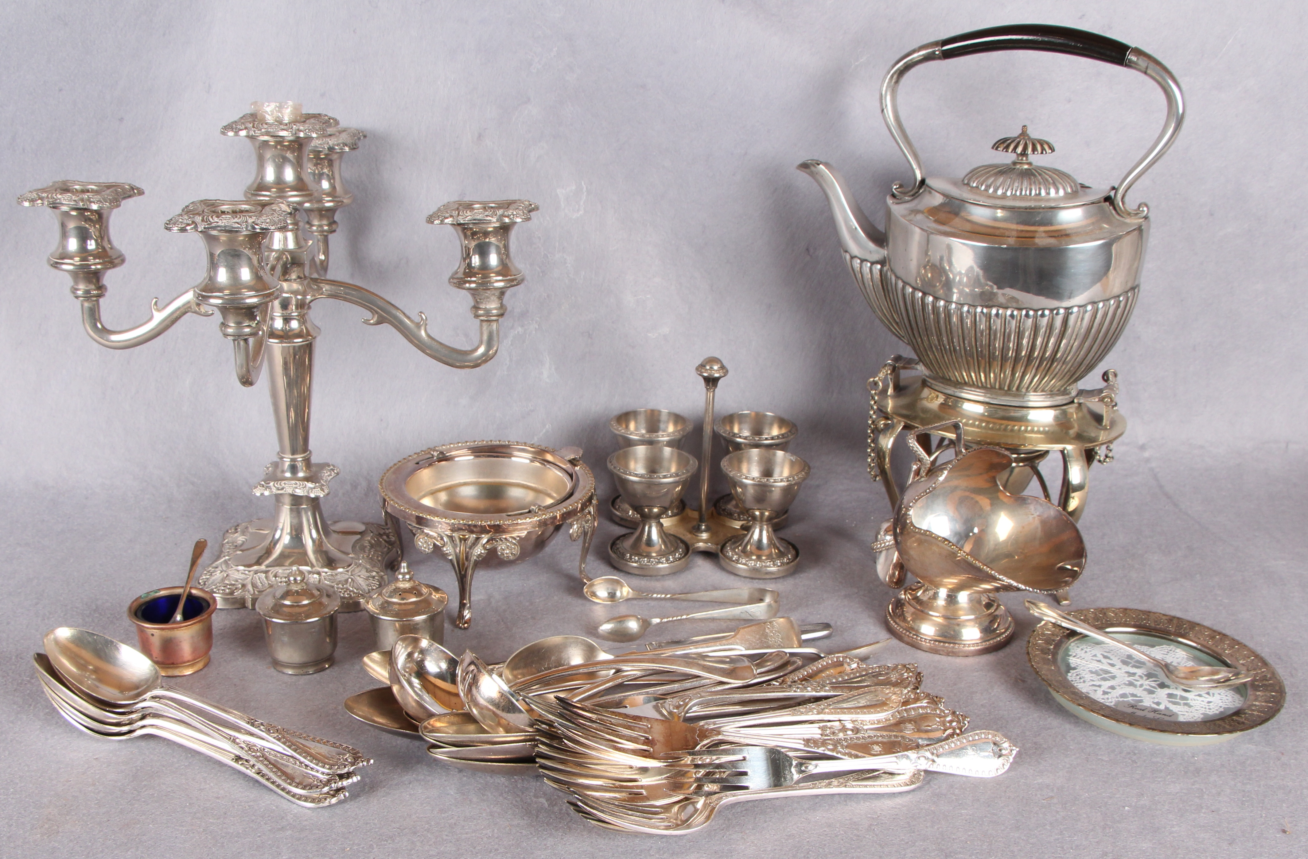 Lot 15 - Plated wares including a spirit kettle with stand and burner,