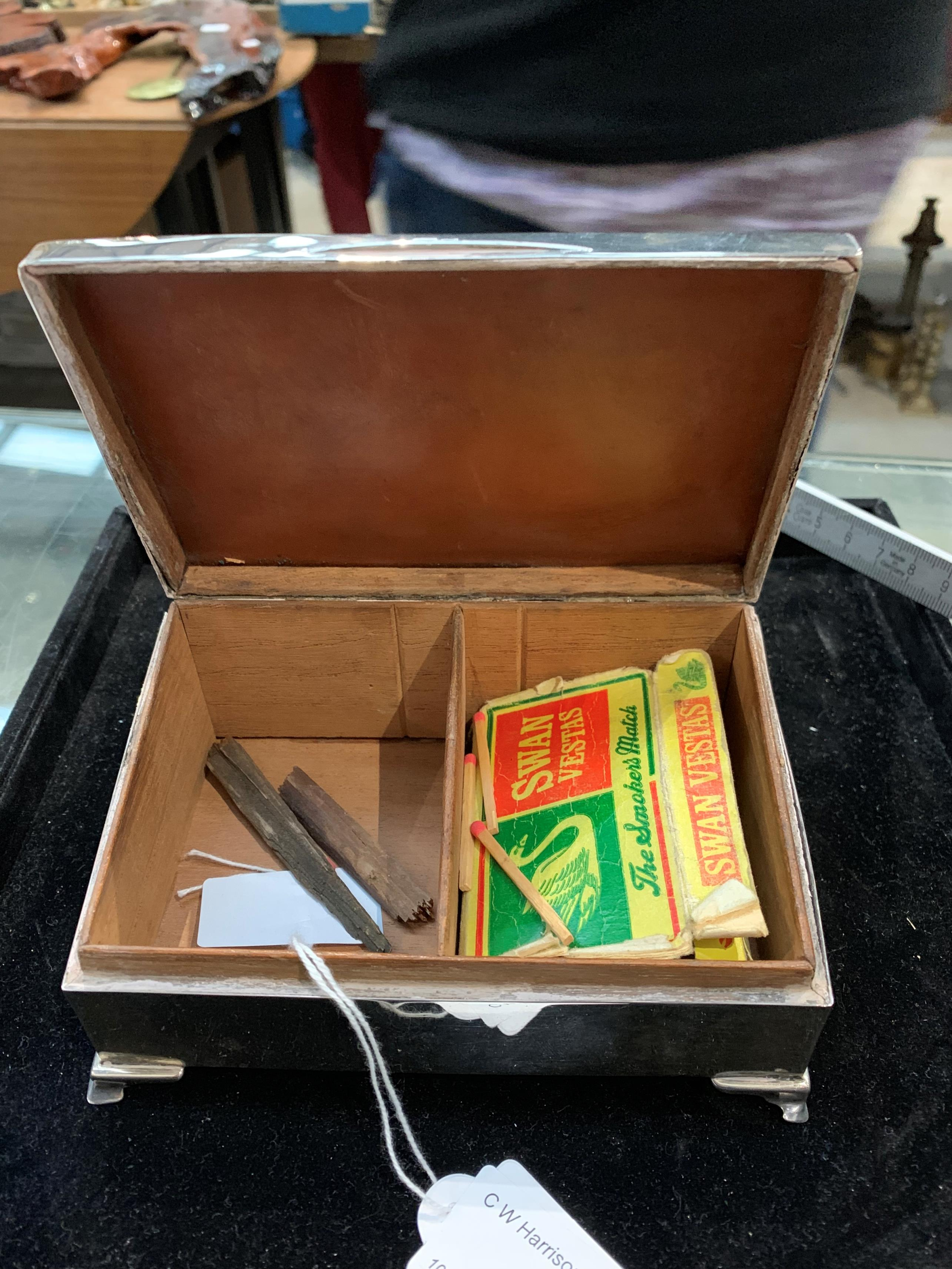Lot 43 - An engine-turned silver cigarette box with hinged, sloping lid, cedar lining,