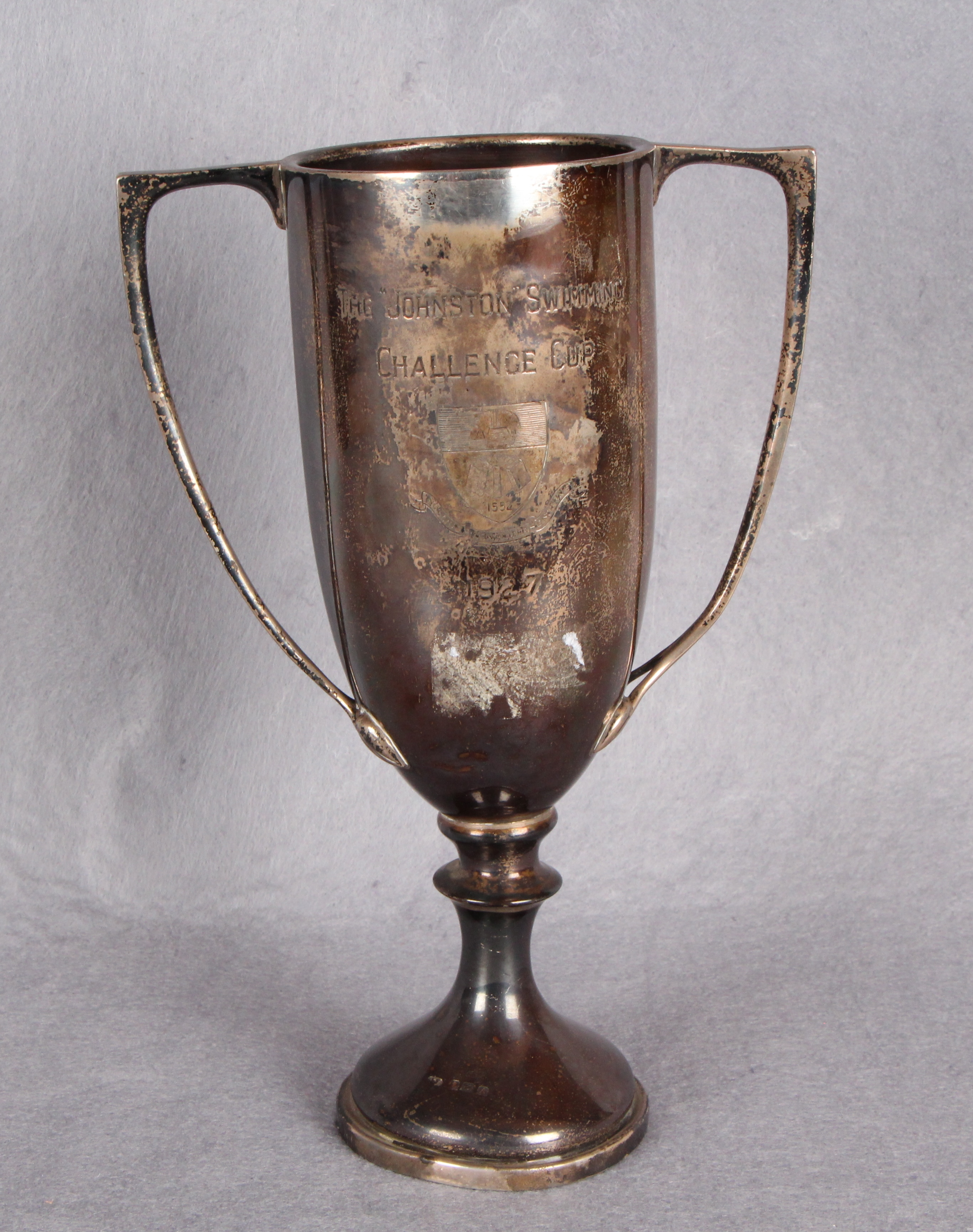 "Lot 31 - A two-handled circular section sports trophy ""The Johnston Swimming Challenge Cup"","