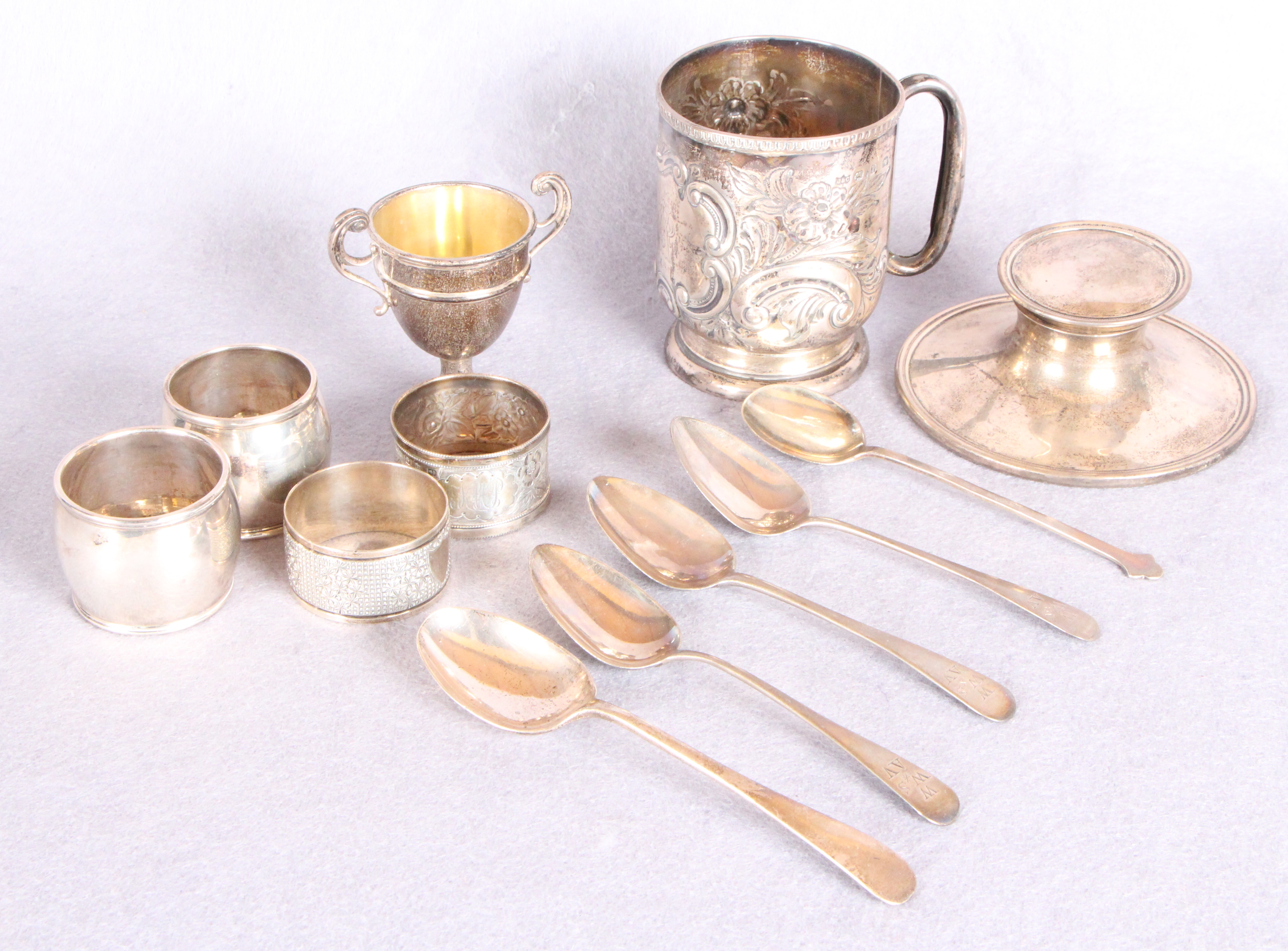 Lot 57 - Silver wares comprising a capstan inkwell (at fault) a late Victorian Christening mug (at fault),
