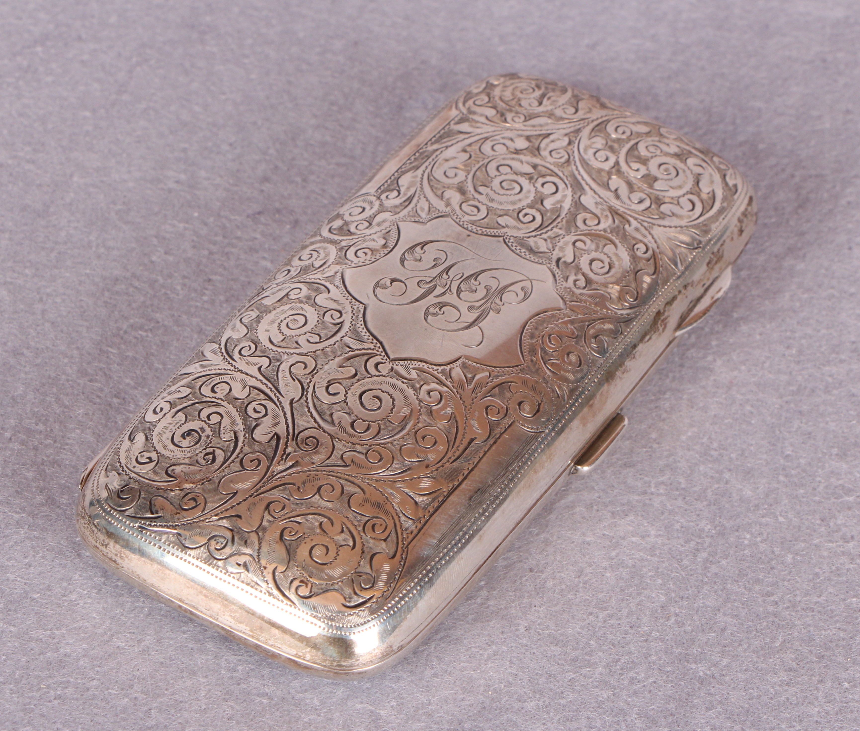 An Edwardian cigar case, overall engraved with foliage, the interior gilt, - Image 3 of 3