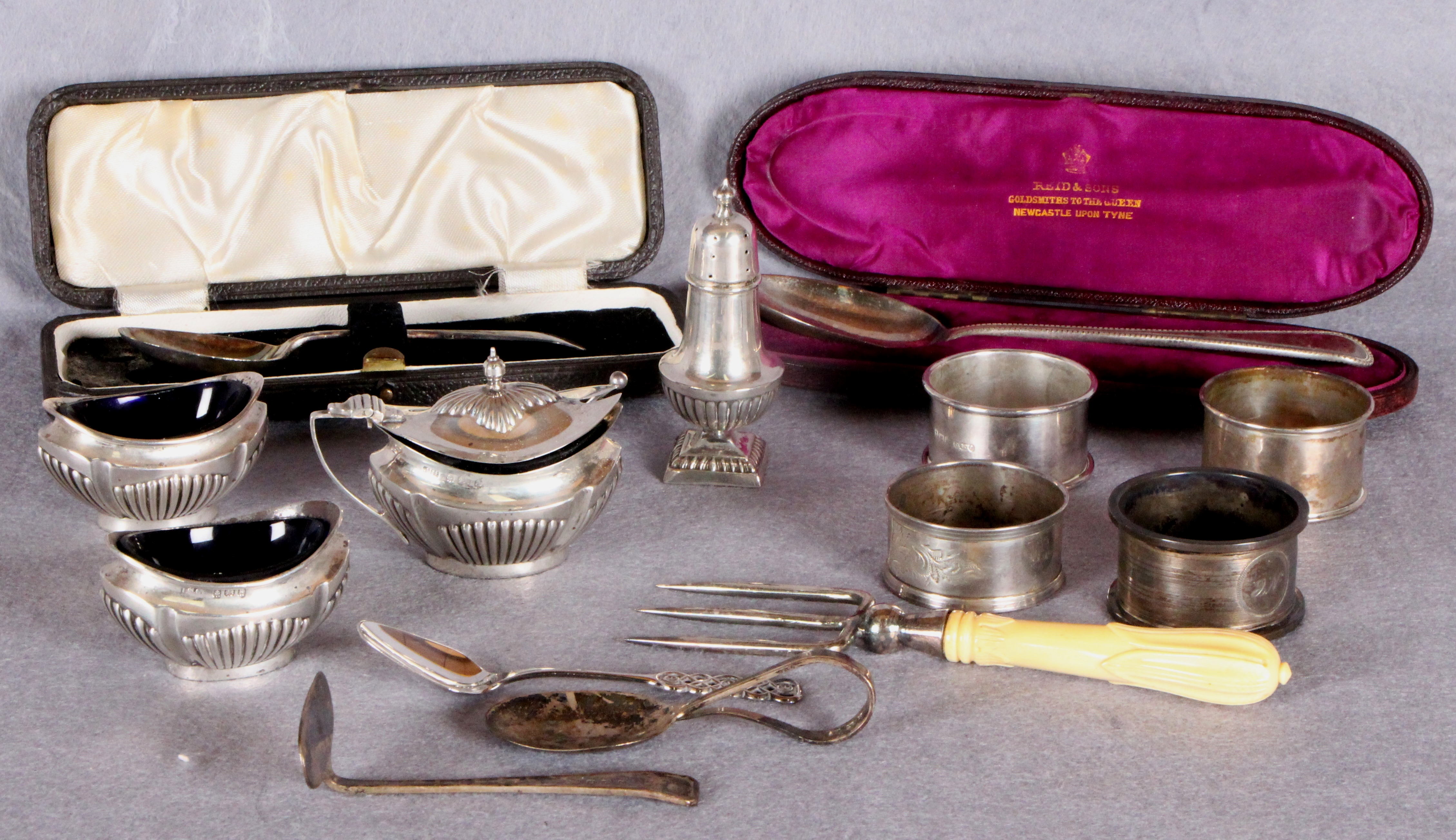 Lot 46 - Small group of silver including four napkin rings; Old English pattern Christening spoon, cased,