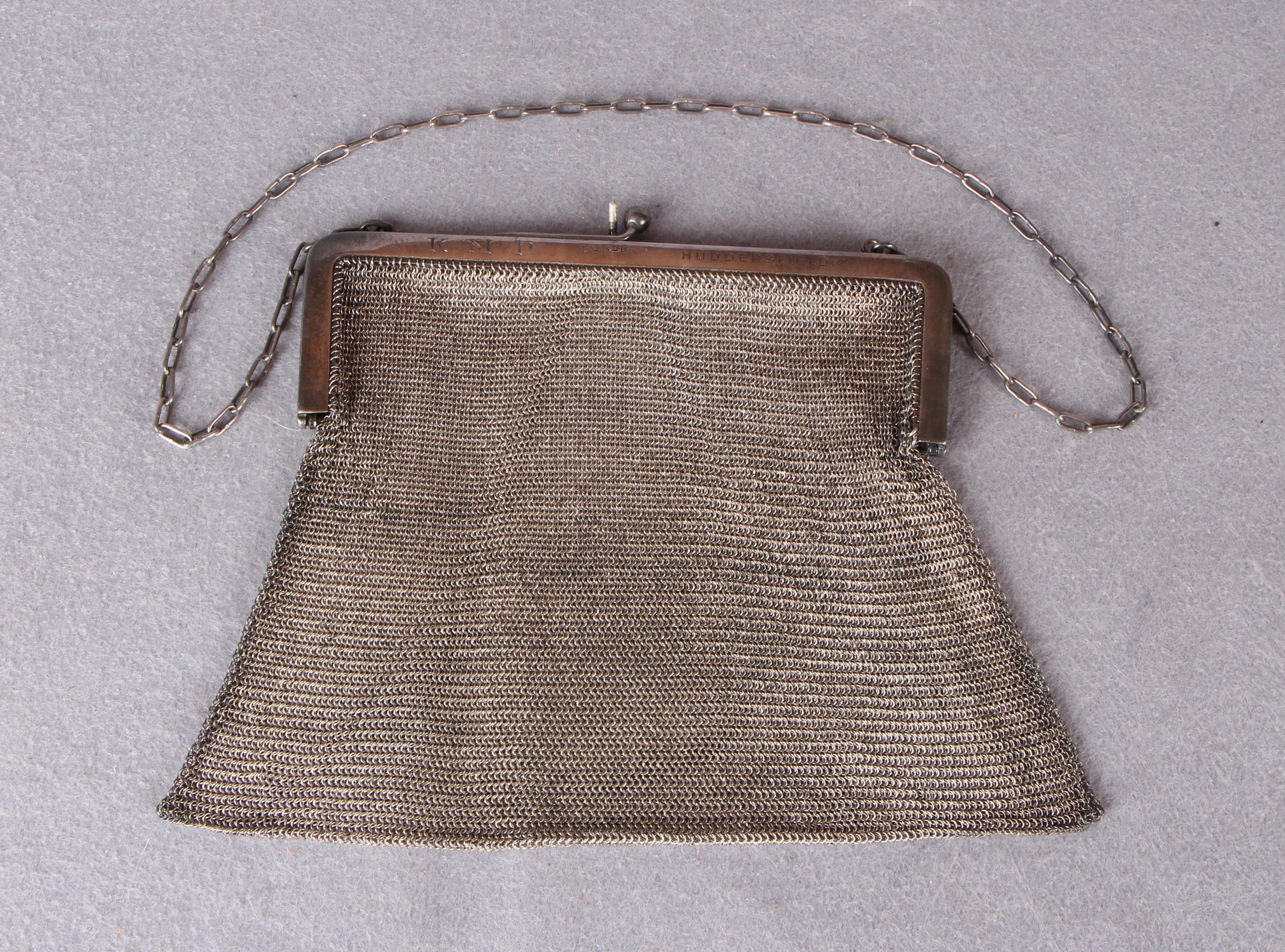 Lot 52 - A continental 925 standard silver mesh evening bag,