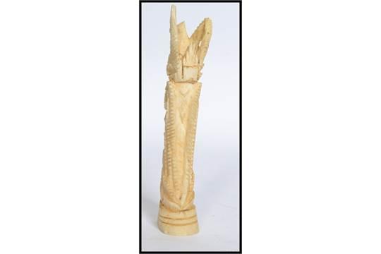 A 20th Century Carved Bone Totem Statue