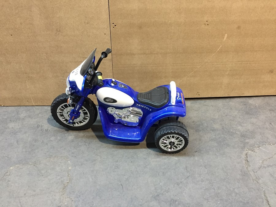 Lot 26 - 1 EX DISPLAY CHILDRENS POLICE ELECTRIC RIDE ON TRICYCLE IN BLUE AND WHITE RRP £149.99