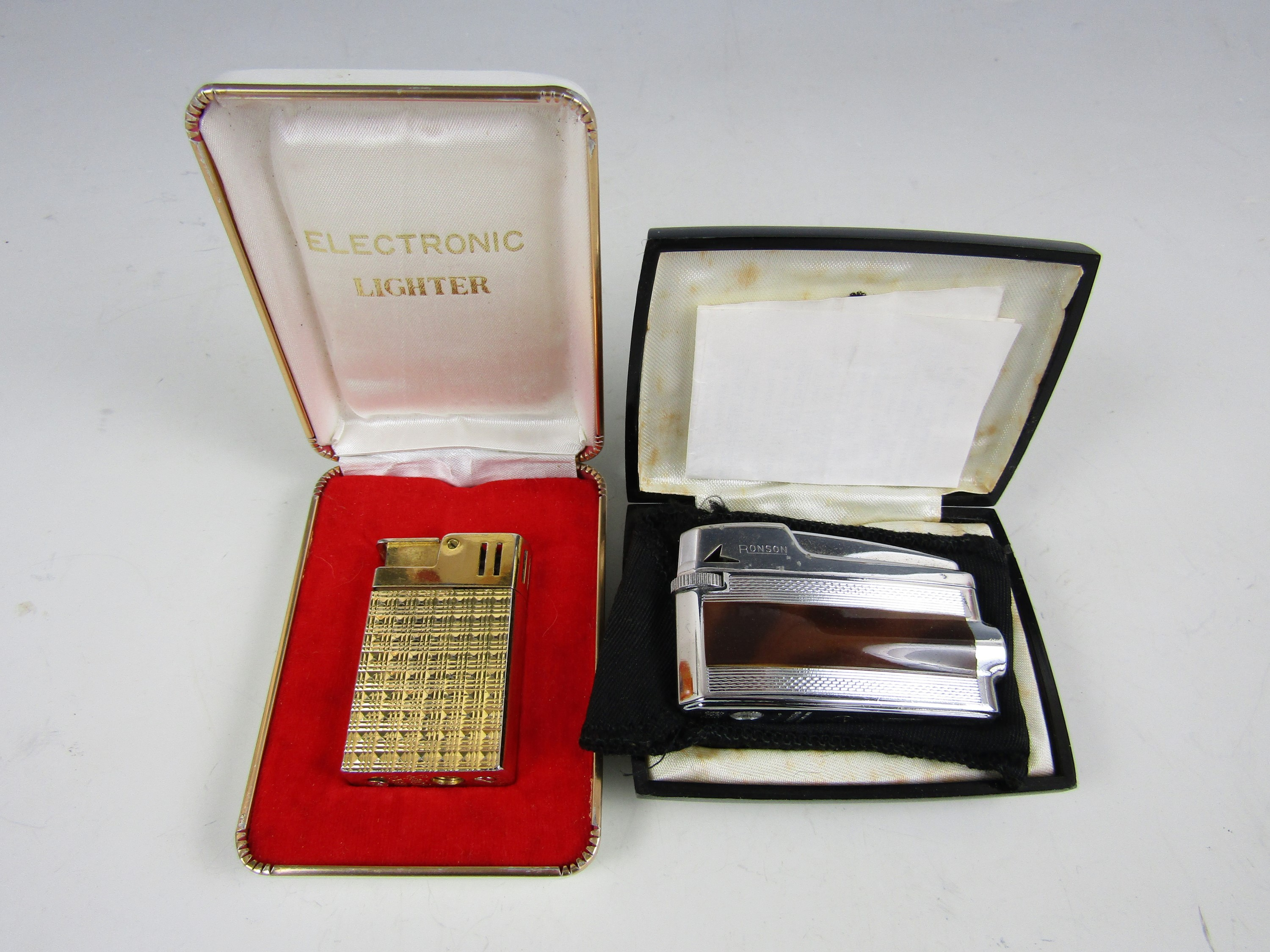 Lot 5 - A cased Ronson Varaflame lighter together with one other electronic lighter