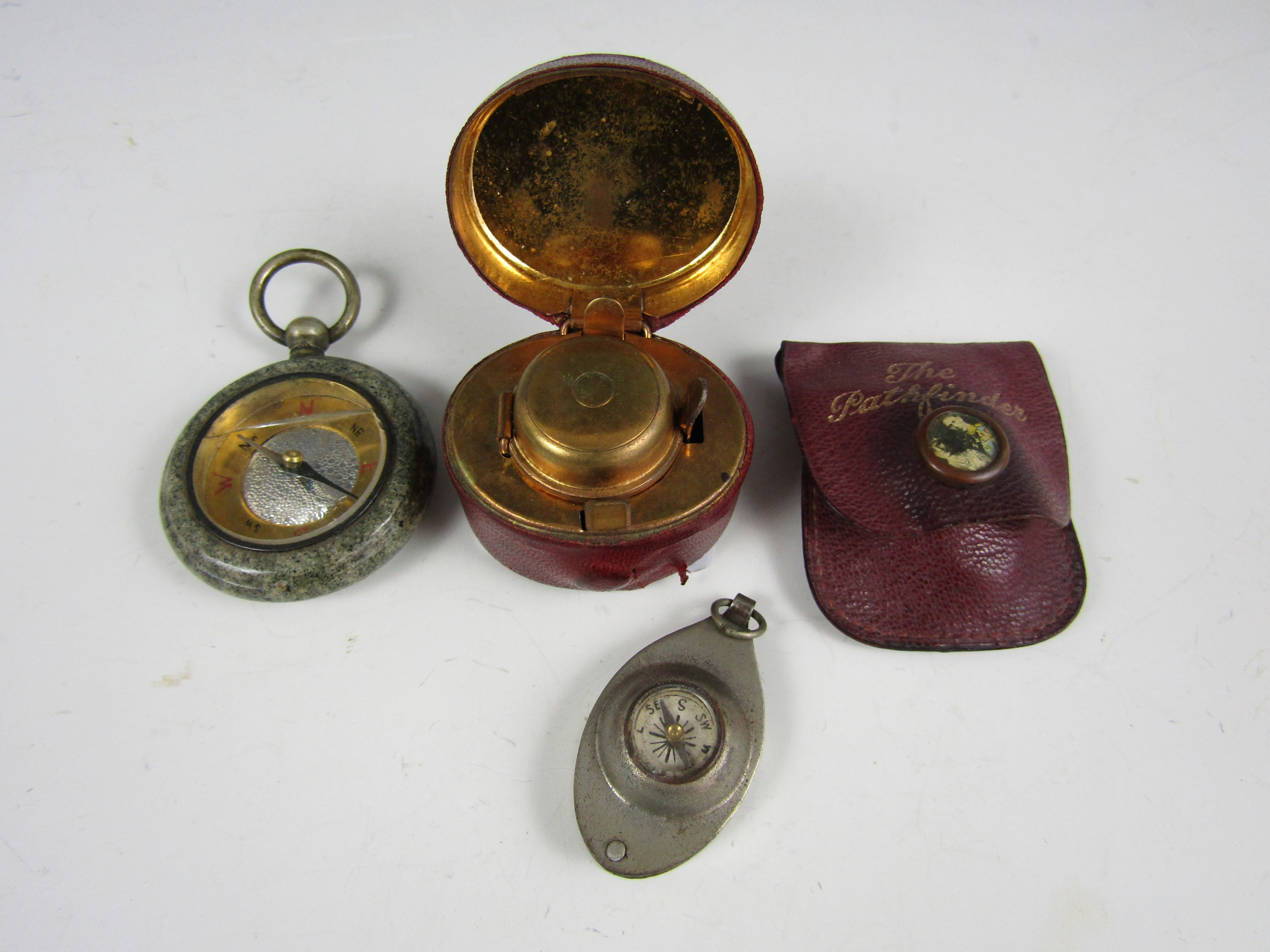 Lot 6 - A portable ink well, together with a pathfinder compass and one other similar