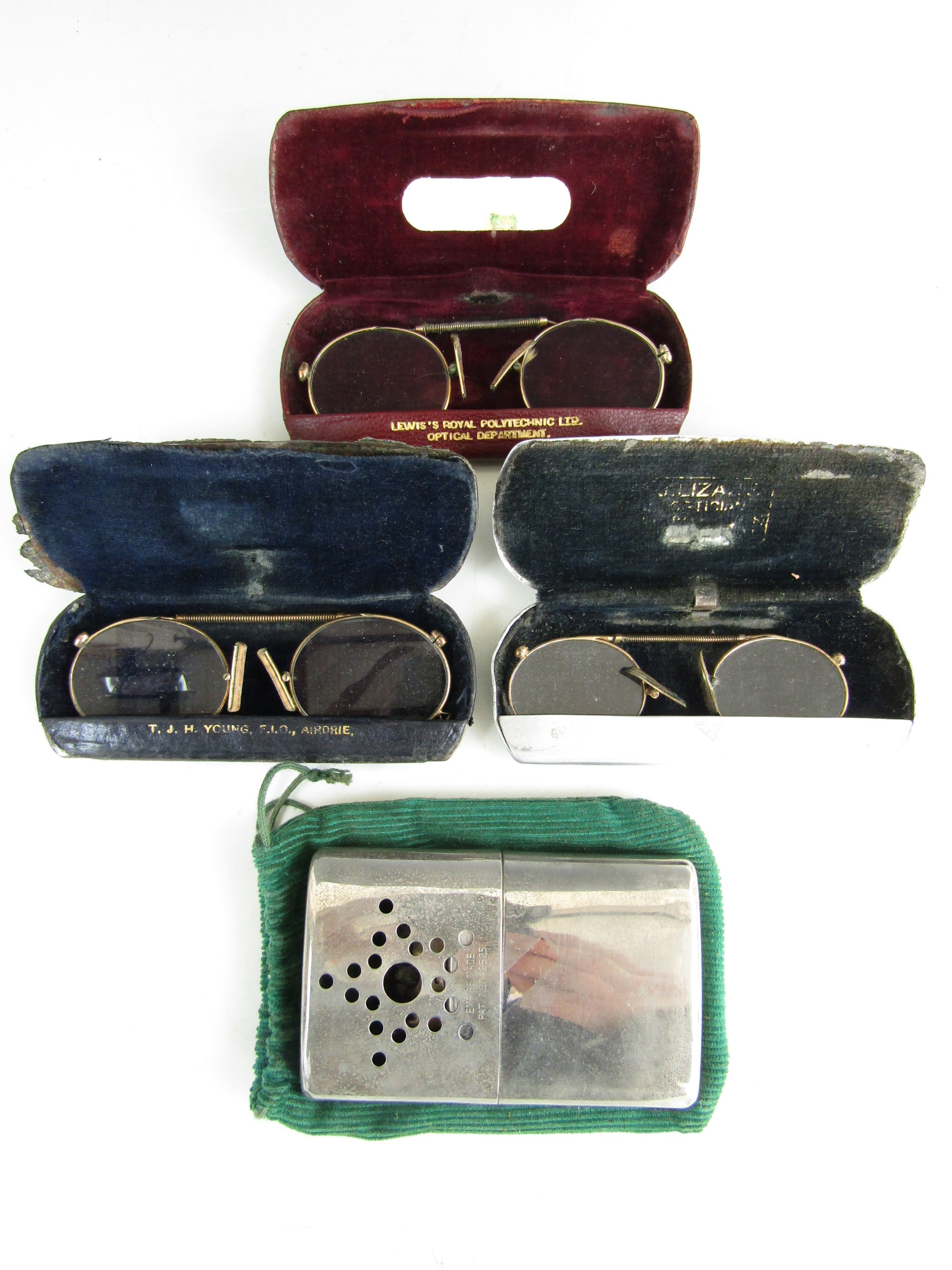 Lot 59 - Three pairs of pince nez spectacles together with a handwarmer