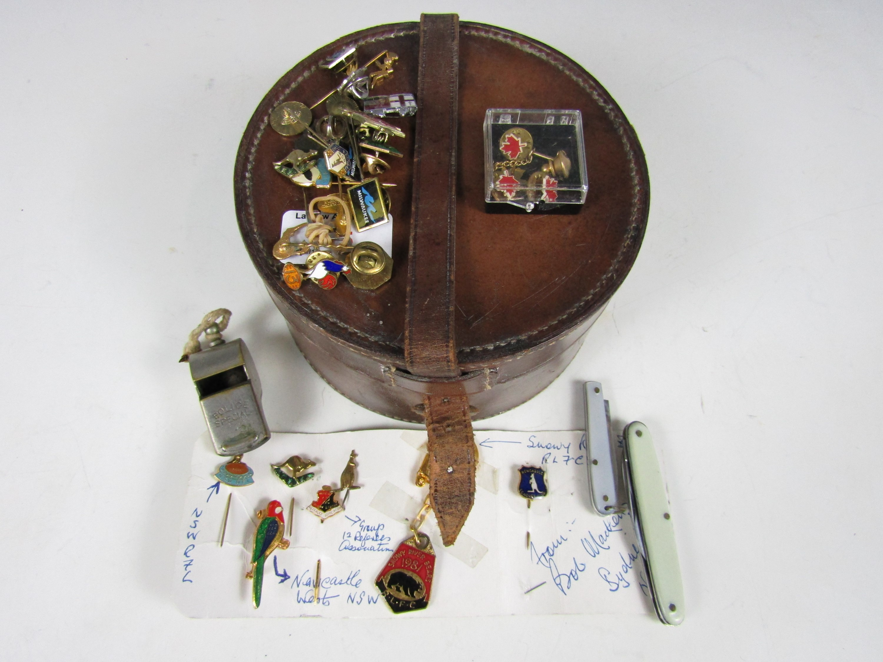 Lot 15 - A vintage collar box, whistle and lapel badges etc.