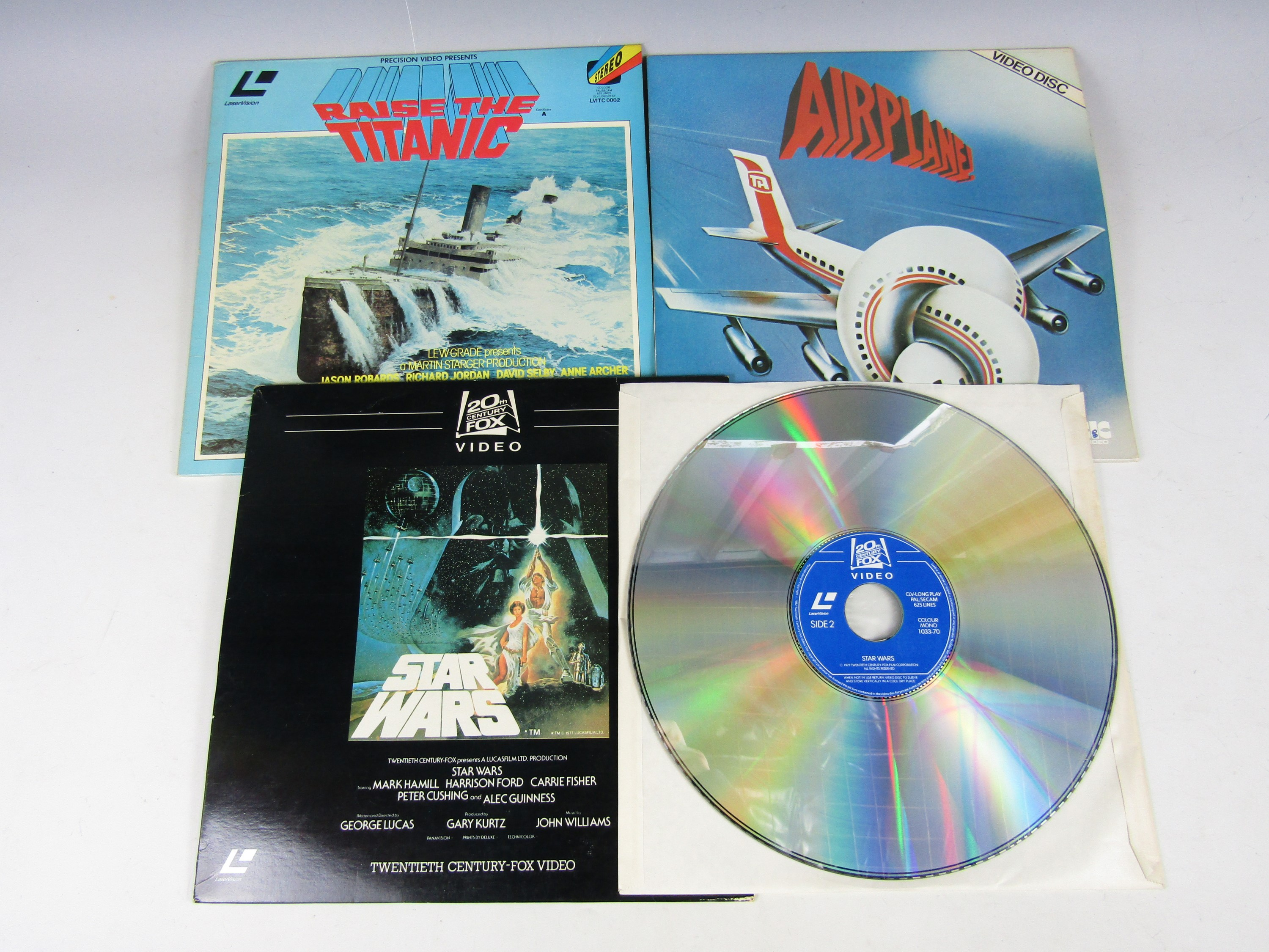Lot 10 - A Star Wars video disc together with an Airplane video disc and Raise the Titanic video disc