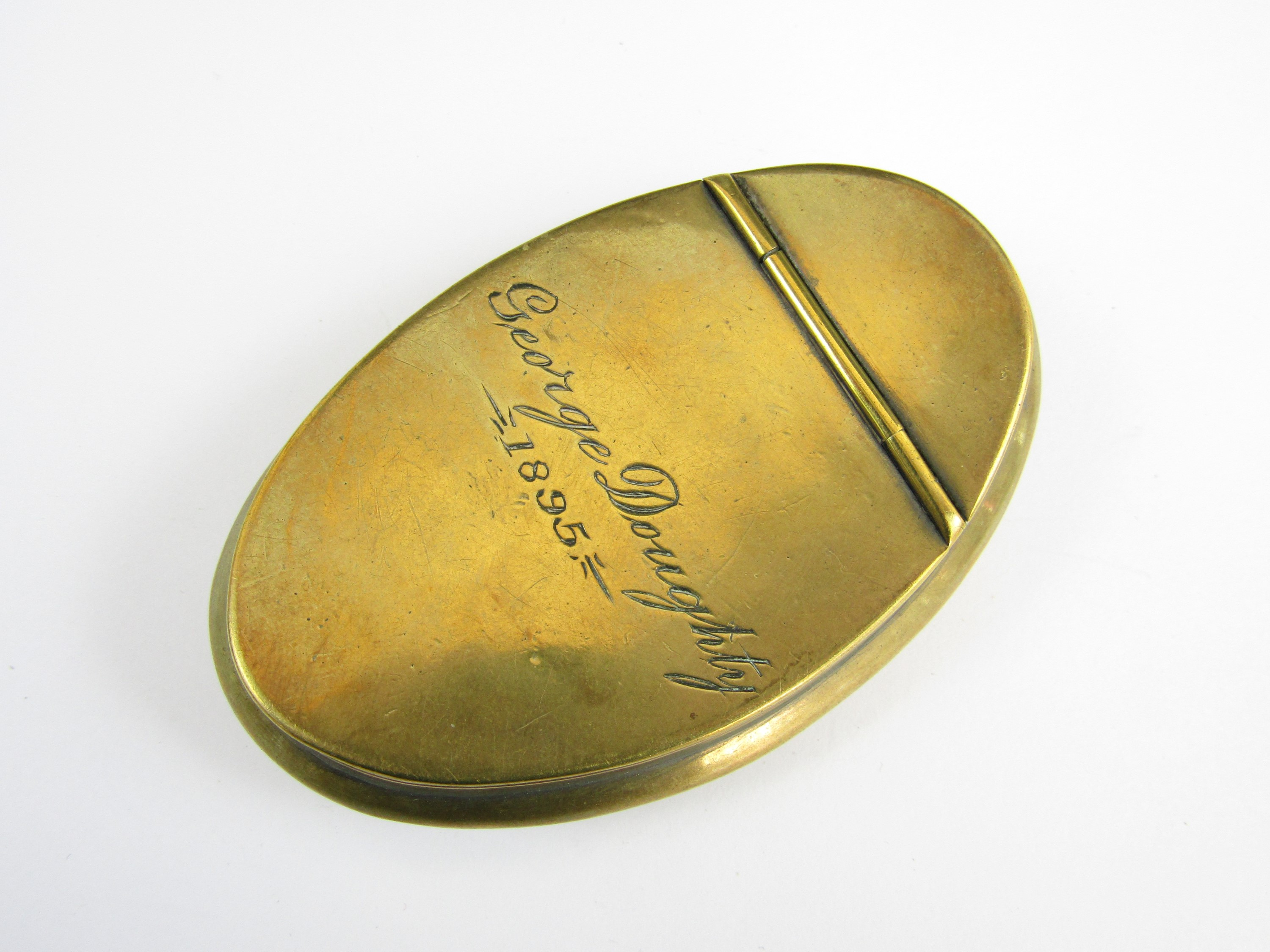 Lot 58 - A brass snuff box engraved George Doughty 1895