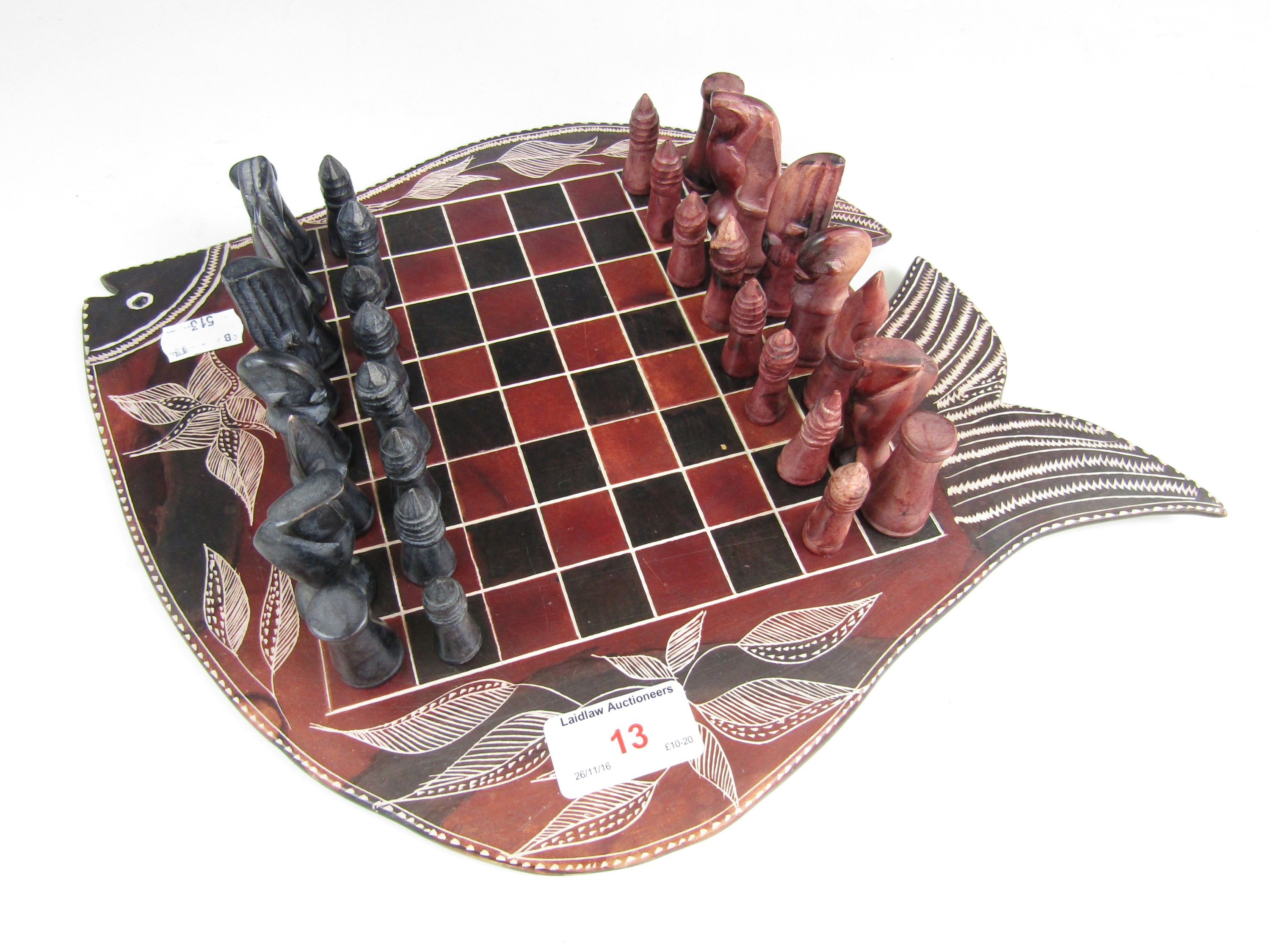 Lot 13 - A soapstone chess board and pieces