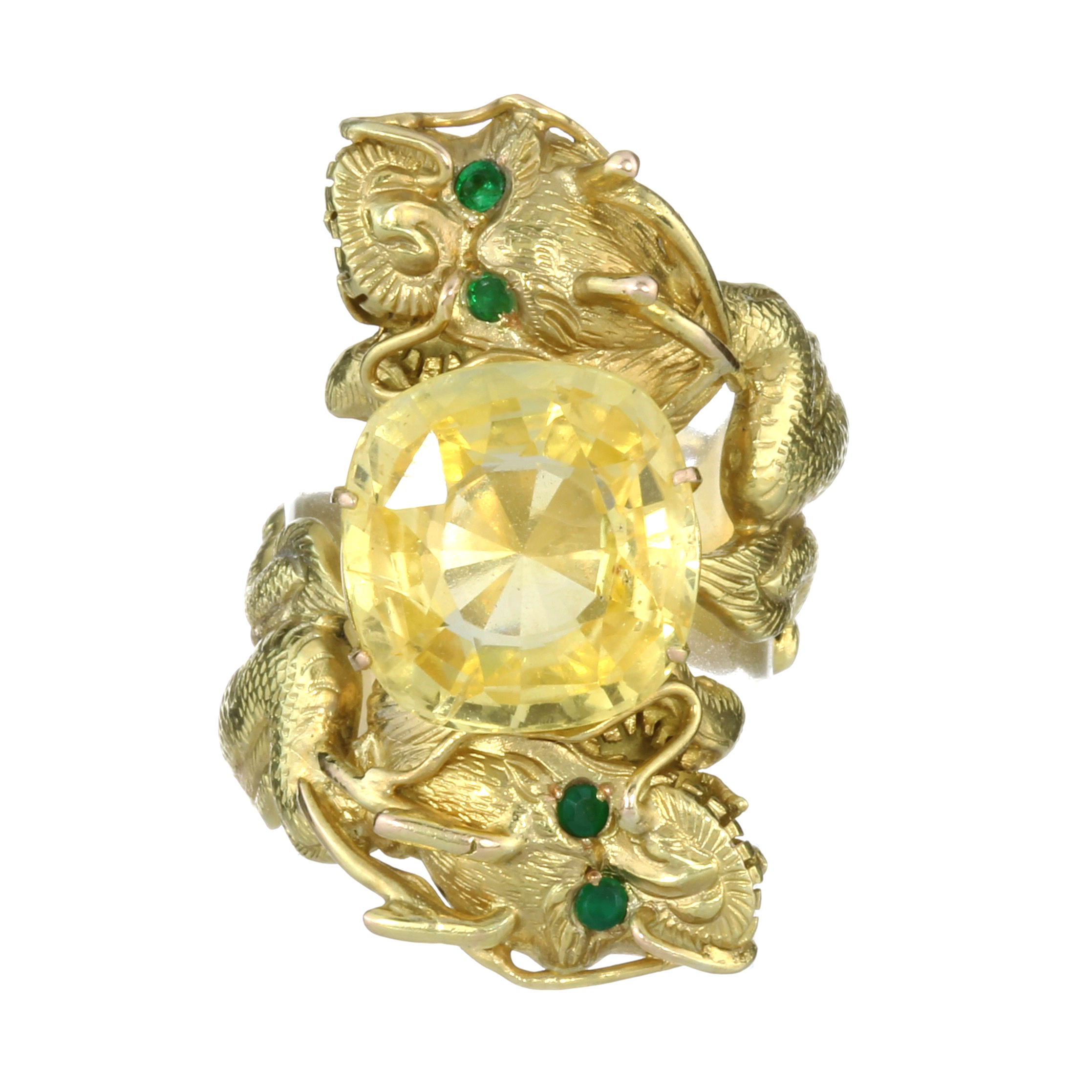 Los 55 - A 10.84 CARAT CEYLON NO HEAT YELLOW SAPPHIRE CHINESE DRAGON RING in yellow gold designed as two