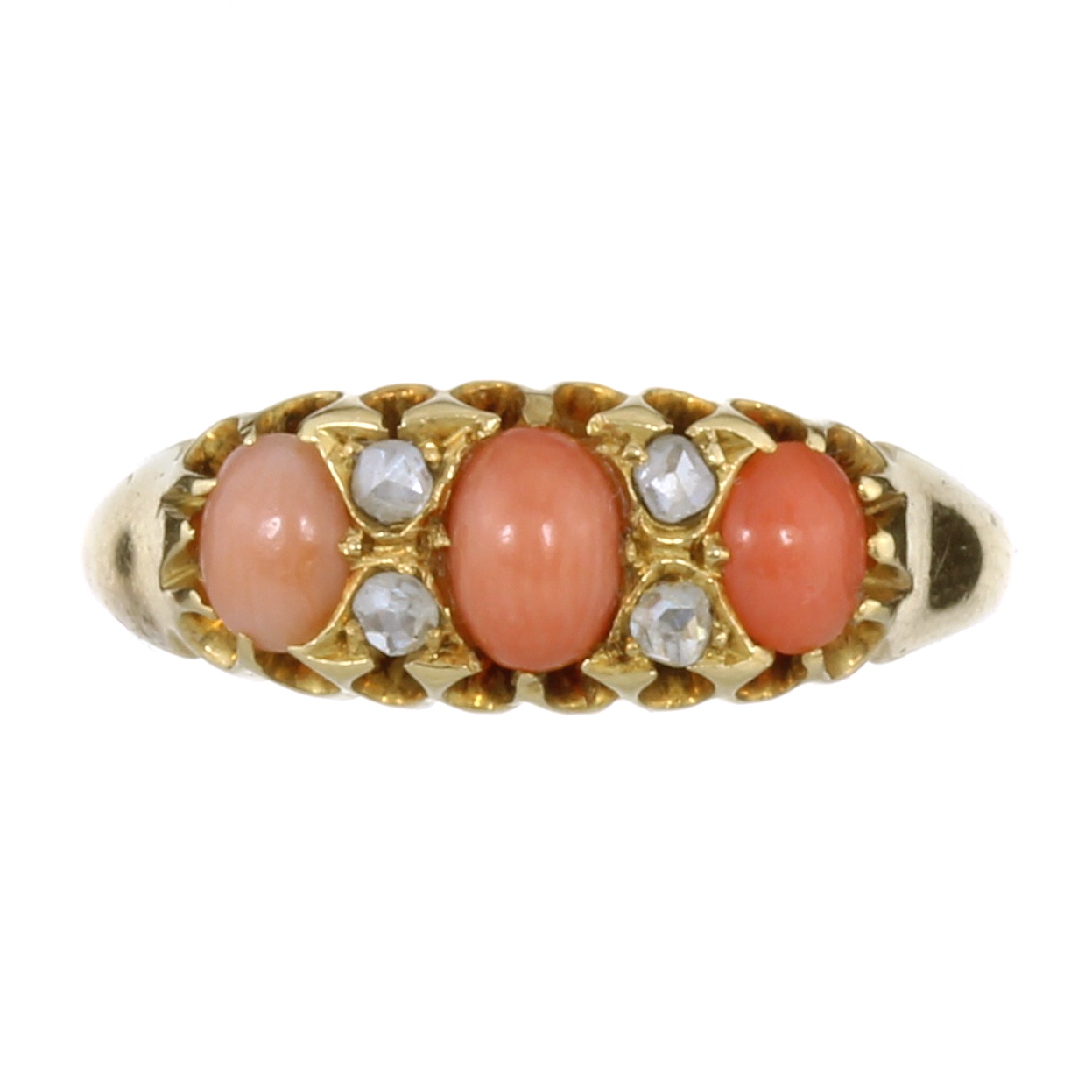 AN ANTIQUE VICTORIAN CORAL AND DIAMOND RING, 1898 in 18ct yellow gold, set with three graduated oval