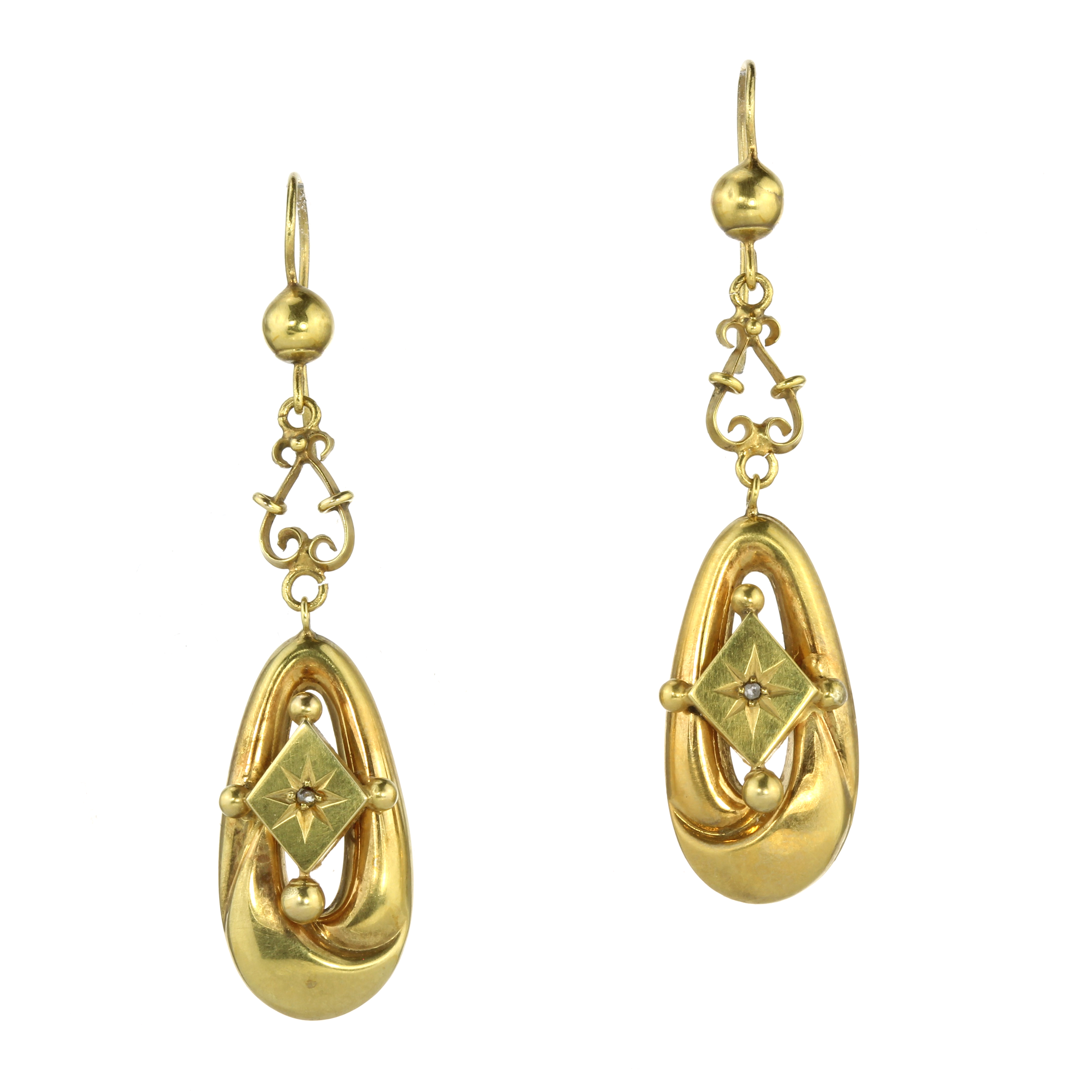 A PAIR OF ANTIQUE DIAMOND DROP EARRINGS in high carat yellow gold, each set with a rose cut