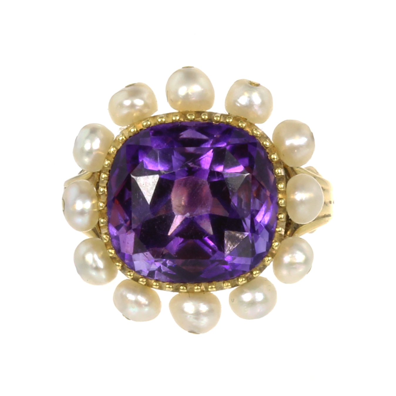 AN AMETHYST AND PEARL DRESS RING set with a central cushion cut amethyst of 8.37 carats within a