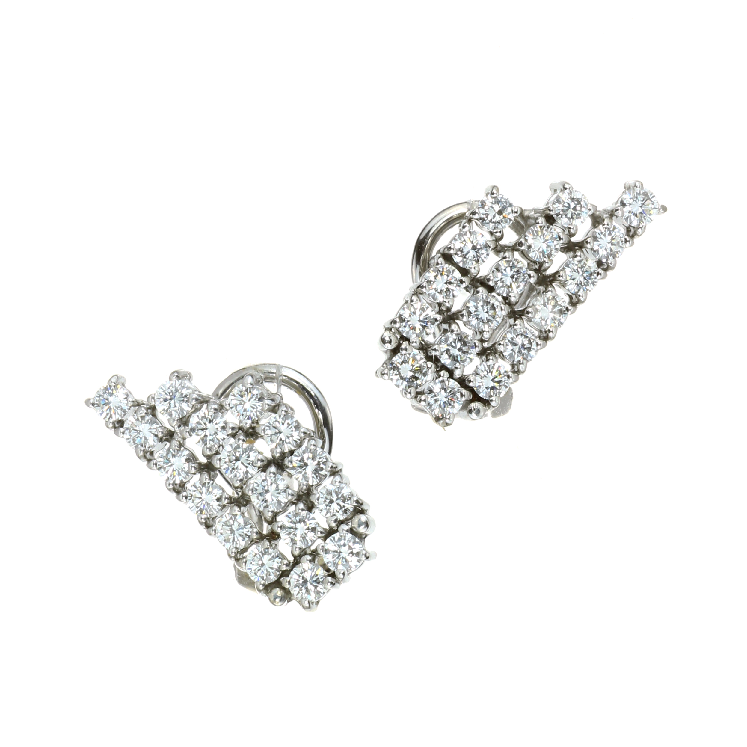 A PAIR OF DIAMOND EARRINGS in white gold or platinum, each set with three rows of round cut diamonds