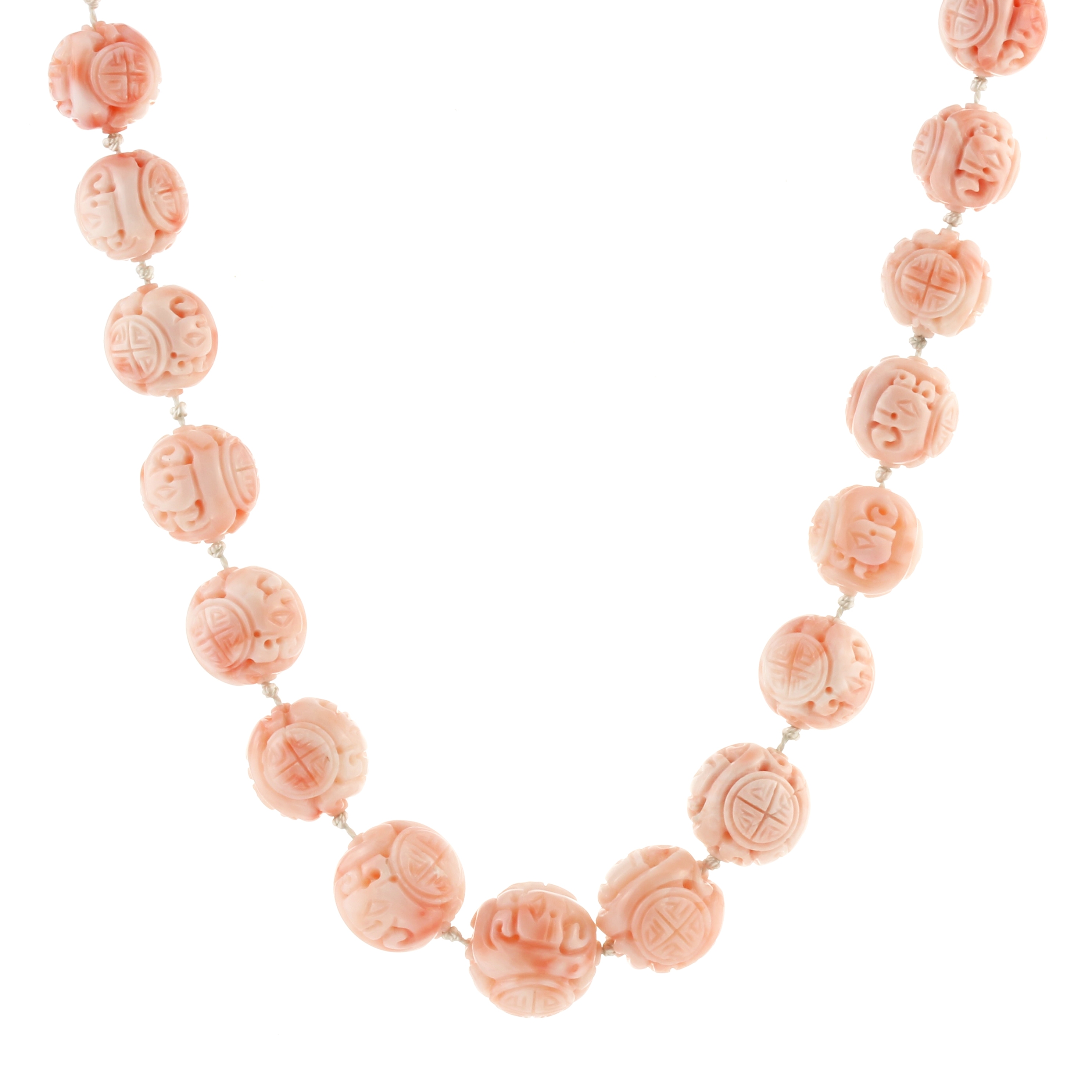 A CHINESE CORAL BEAD NECKLACE comprising a single row of thirty two graduated carved coral beads