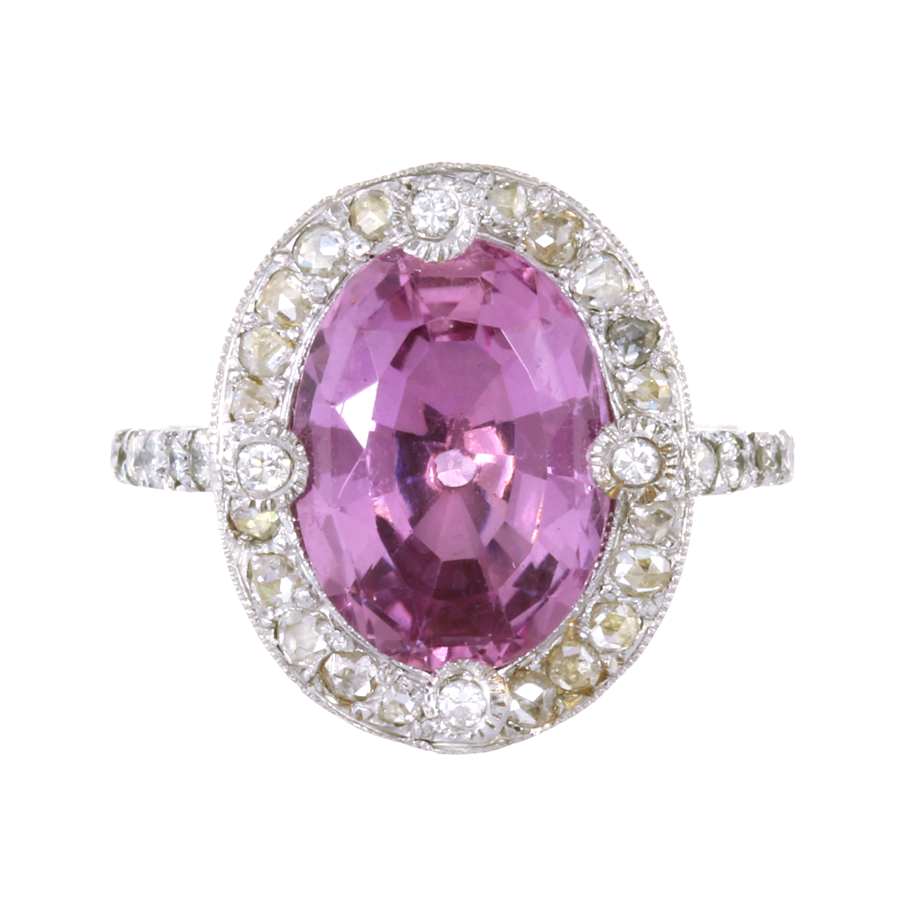 A PINK TOPAZ AND DIAMOND RING in platinum set with a central oval cut pink topaz of 6.25 carats
