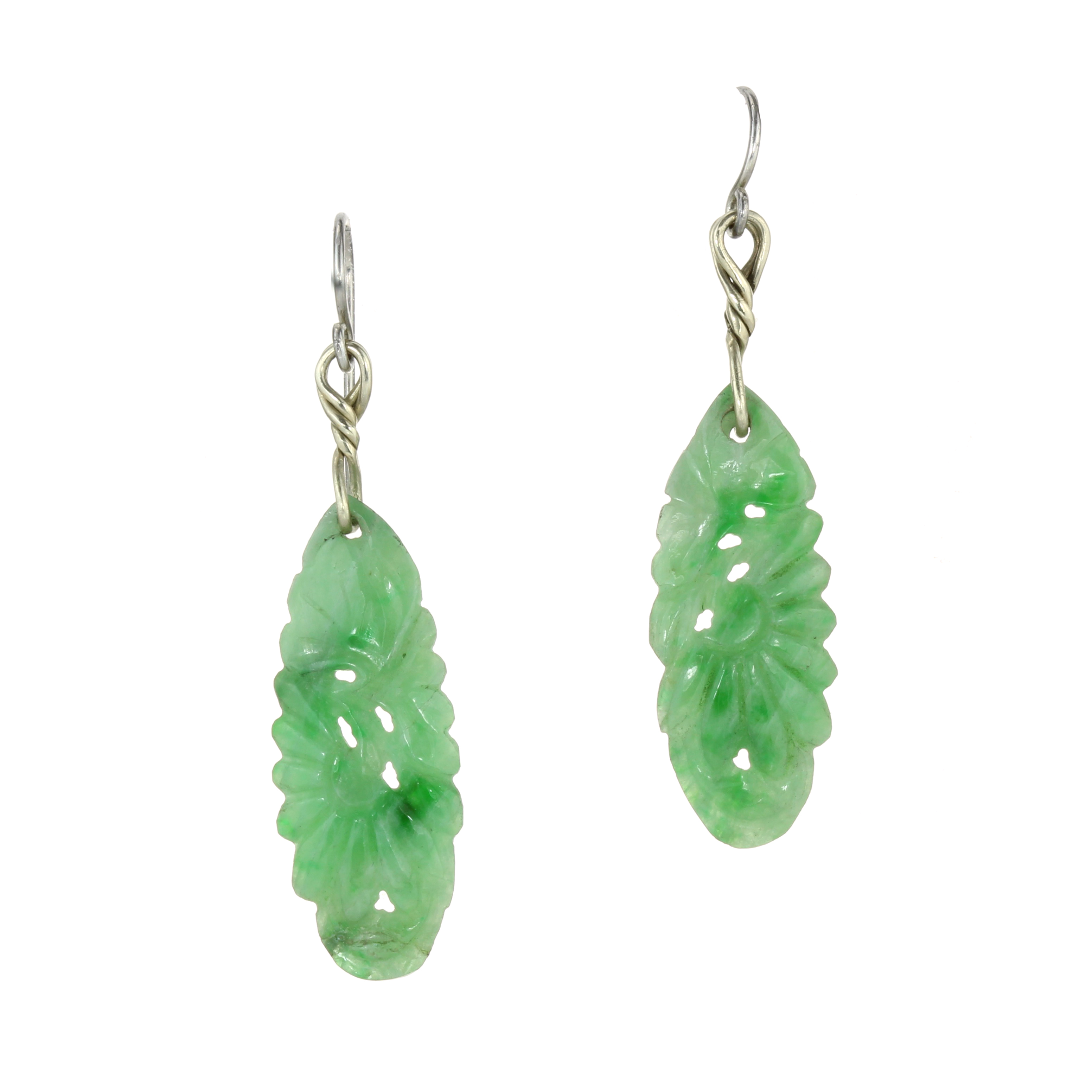 Los 23 - AN PAIR OF CARVED JADE EARRINGS in white gold and silver, each set with an elongated carved piece of