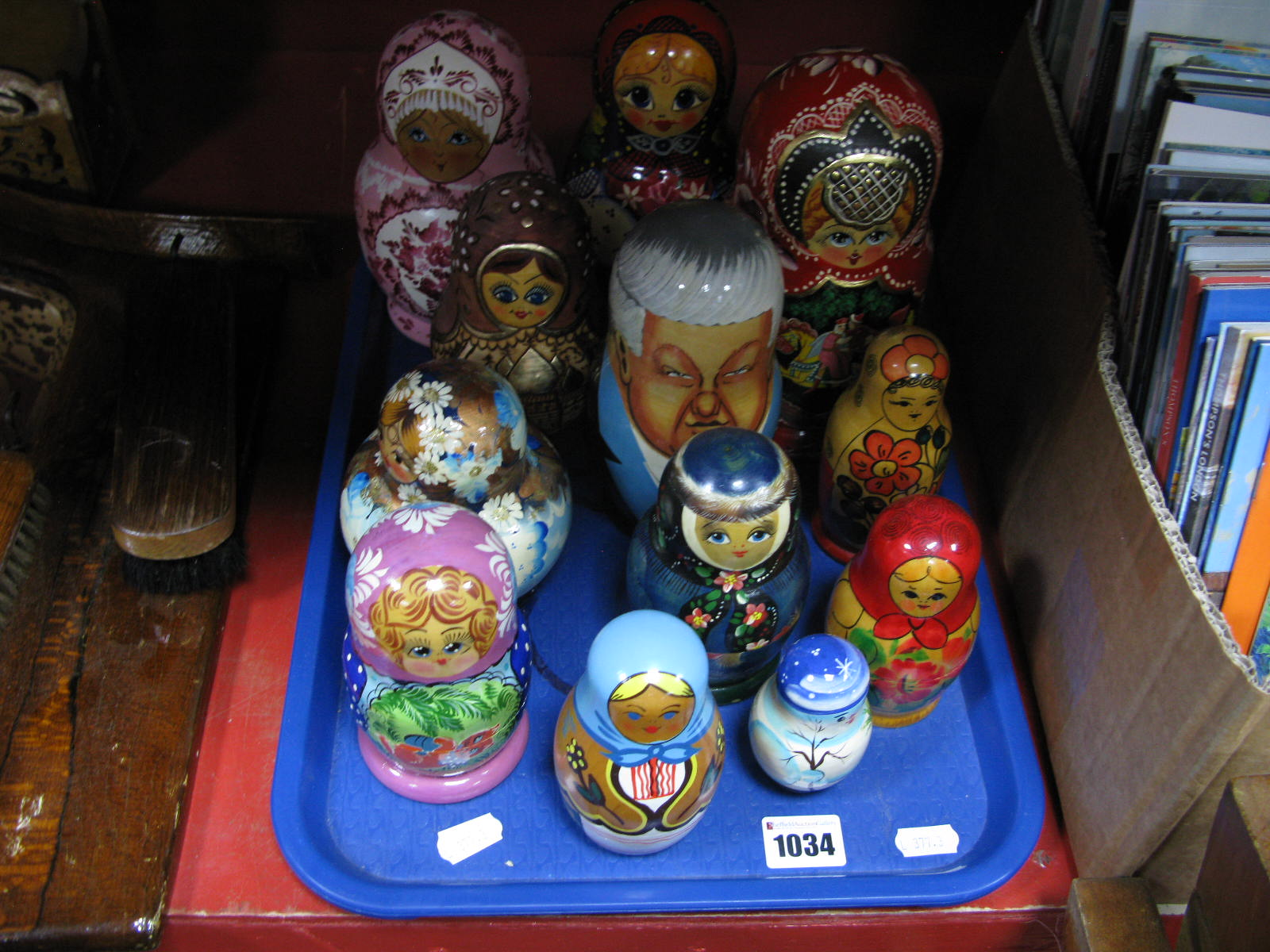 Lot 1034 - A Collection of Twelve Russian Doll Babushka's, varying sizes and designs including Yeltsin:- One