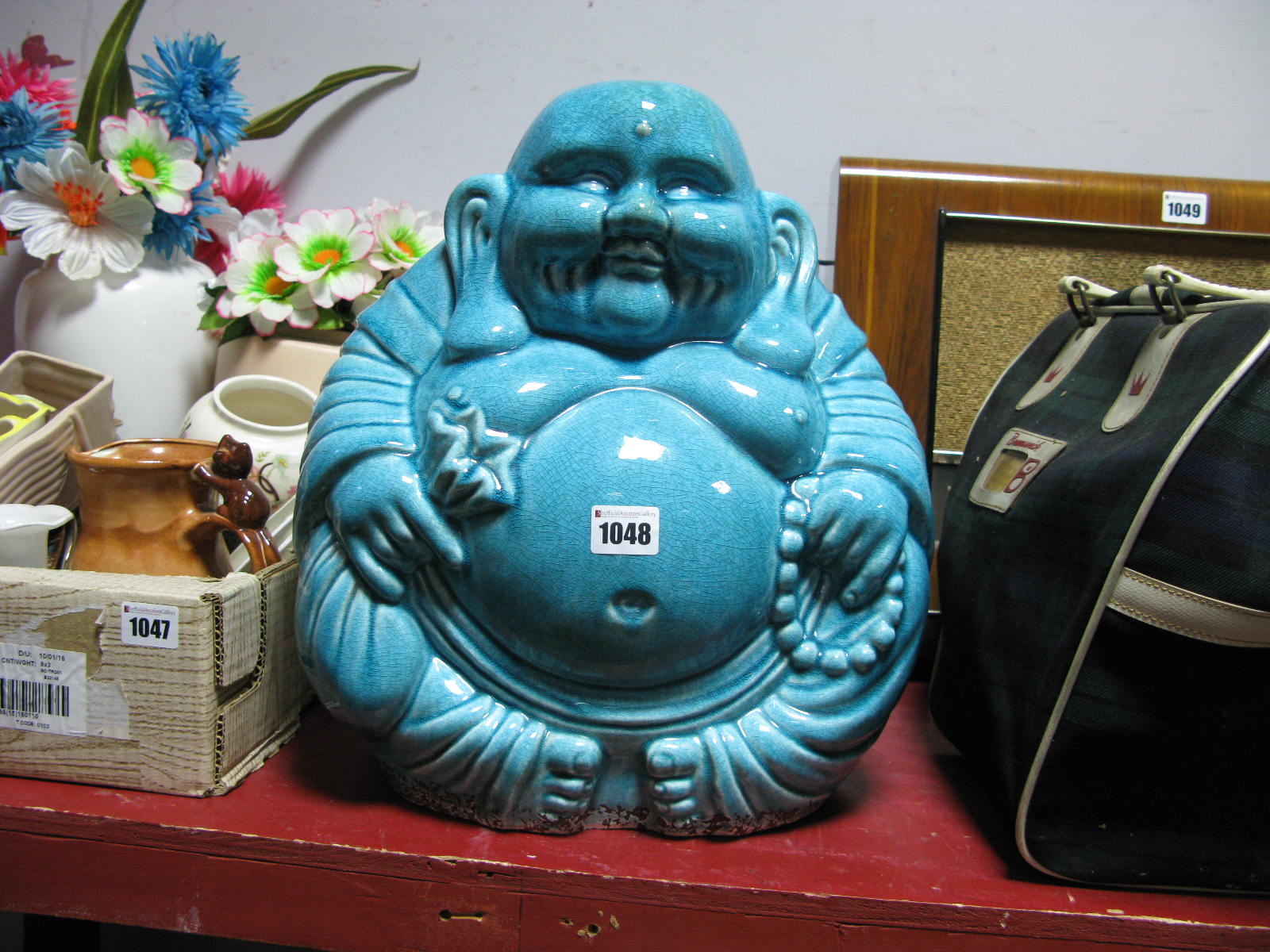 Lot 1048 - A Turquoise Glazed Pottery Seated Buddah, 37cm high.