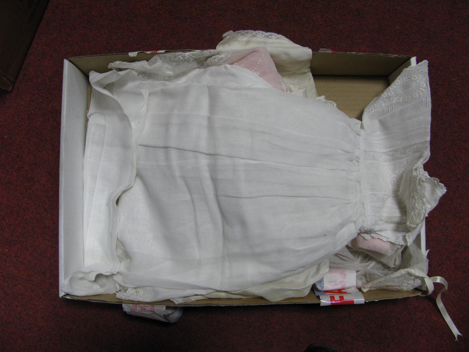 Lot 1036 - Four Early XX Century Christening Gowns, with lace and crochet work.