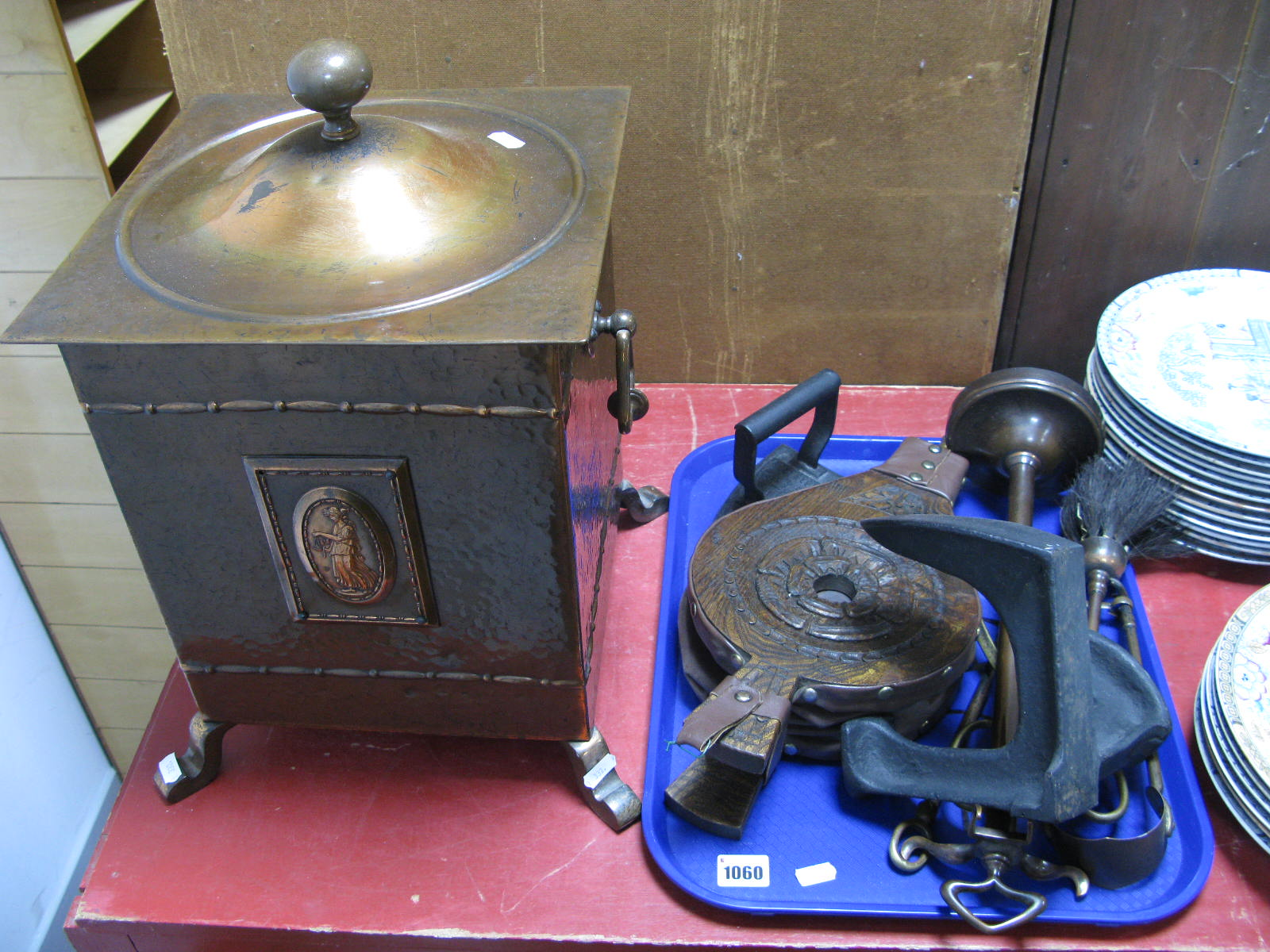 Lot 1060 - A Circa 1930's Oxidised Copper Coal Box, with planished finish, companion set, bellows, shoe last,